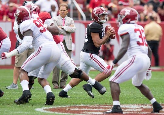 Alabama quarterback Tua Tagovailoa (13) looks to pass during first half action in the Alabama A-Day spring football scrimmage game at Bryant Denny Stadium in Tuscaloosa, Ala., on Saturday April 13, 2019.