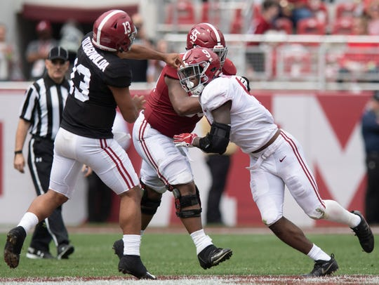 Alabama quarterback Tua Tagovailoa (13) passes as offensive lineman Emil Ekiyor, Jr., (55) protects him from the pass rush of linebacker Eyabi Anoma (9) during second half action in the Alabama A-Day spring football scrimmage game at Bryant Denny Stadium in Tuscaloosa, Ala., on Saturday April 13, 2019.