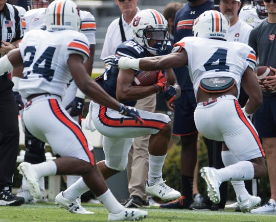 Auburn running back Harold Joiner (22) is pushed out of bounds by Auburn defensive back Noah Igbinoghene (4) during the A-Day spring practice game at Jordan-Hare Stadium in Auburn, Ala., on Saturday, April 13, 2019.