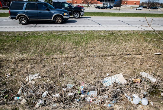 Litter collects in a ditch along McGalliard Road in front of Walmart and Lowe's in Muncie.