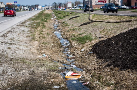 Litter collects in the ditch along McGalliard Road in front of Walmart and Lowe's in Muncie.