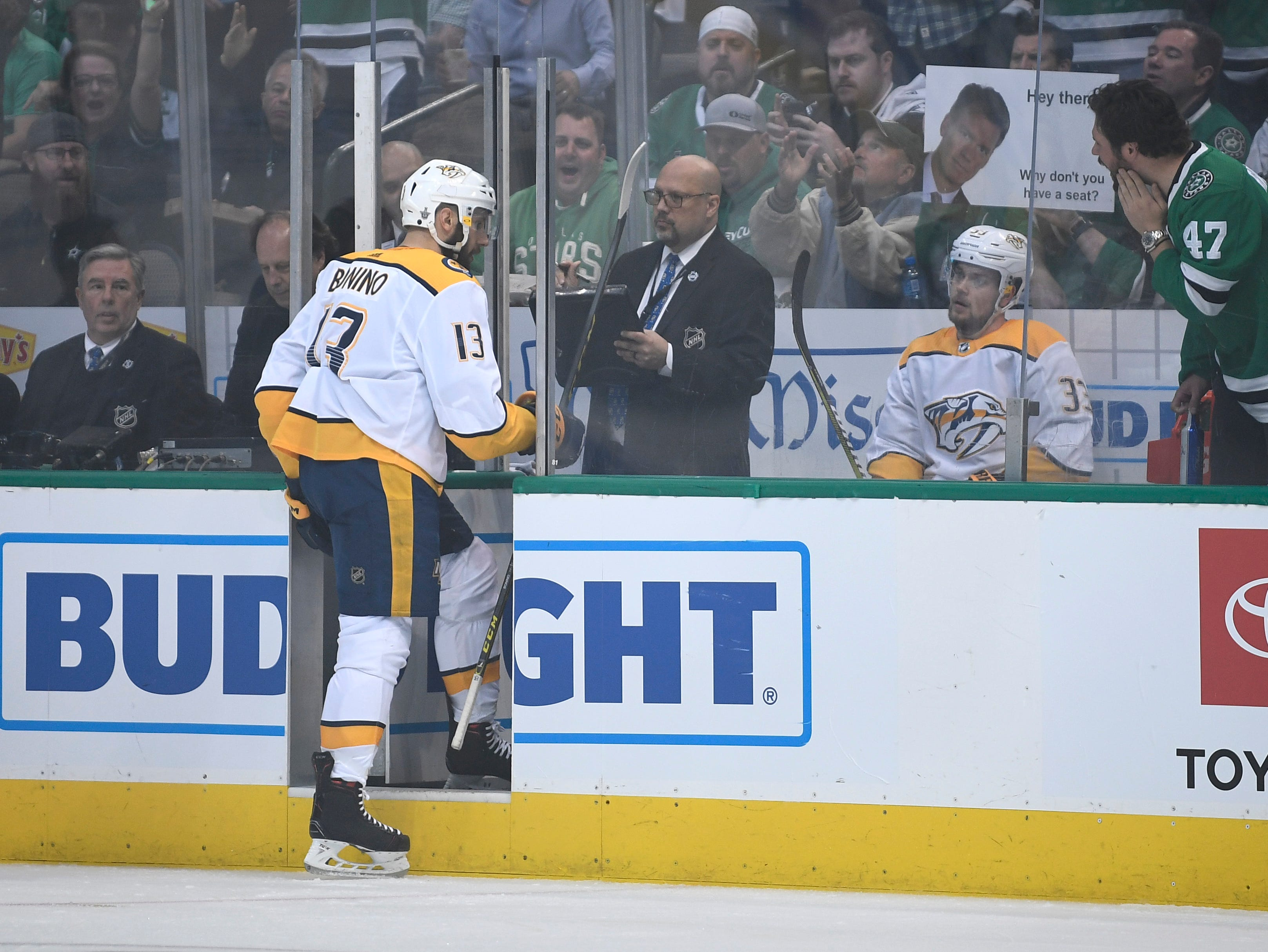 Nashville Predators center Nick Bonino (13) joins right wing Viktor Arvidsson (33) in the penalty box during the second period of the divisional semifinal game at the American Airlines Center in Dallas, Texas., Monday, April 15, 2019.