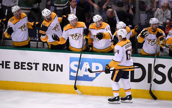 Nashville Predators center Mikael Granlund (64) celebrates his game-winning goal during the third period of the divisional semifinal game against the Dallas Stars at the American Airlines Center in Dallas, Texas., Monday, April 15, 2019.