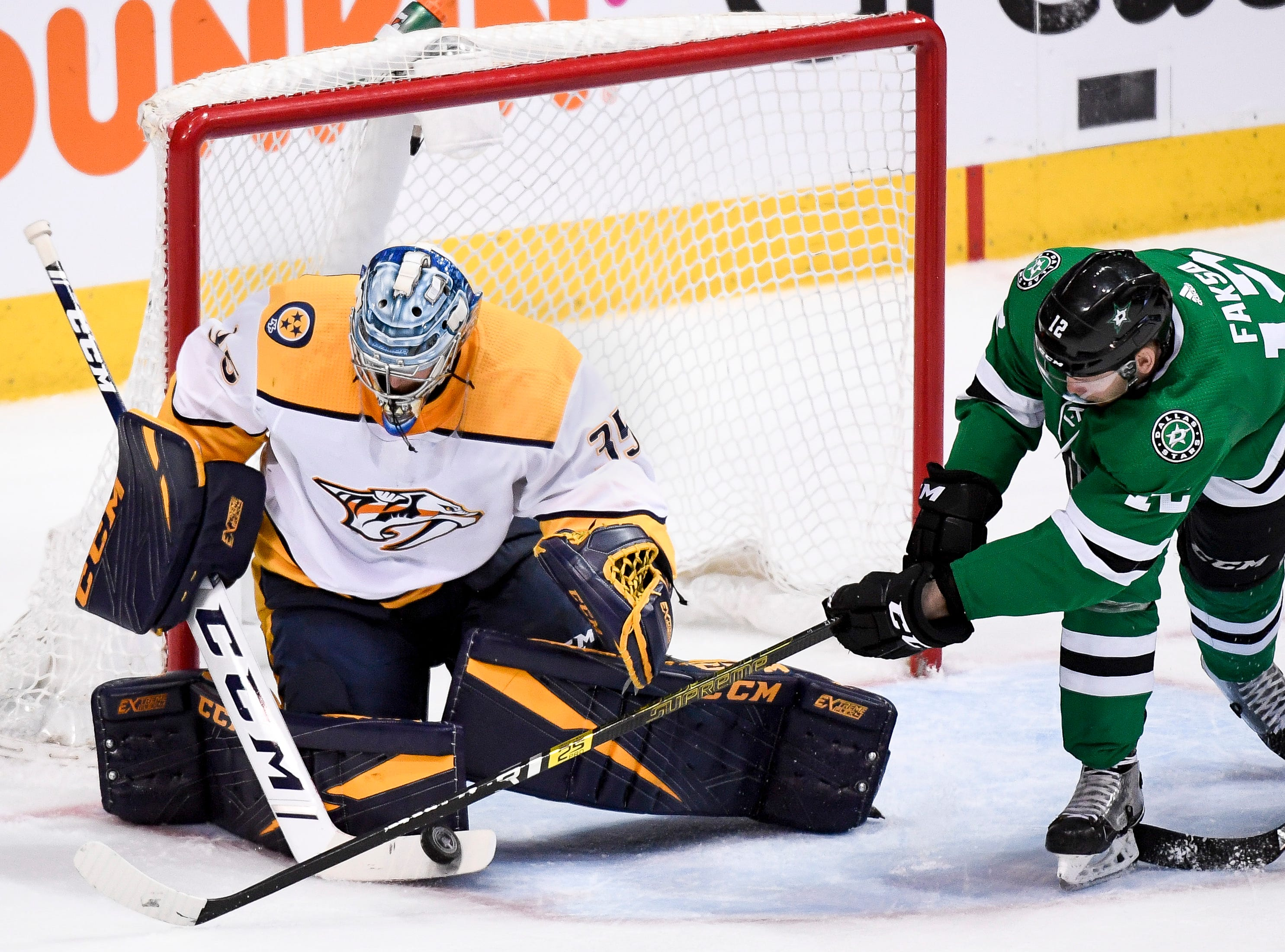 Nashville Predators goaltender Pekka Rinne (35) defends against Dallas Stars center Radek Faksa (12) during the third period of the divisional semifinal game at the American Airlines Center in Dallas, Texas., Monday, April 15, 2019.