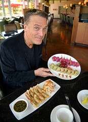 Michael W. Smith visits one of his favorite places in town, Wild Ginger, on Tuesday, April 16, 2019, in Franklin.