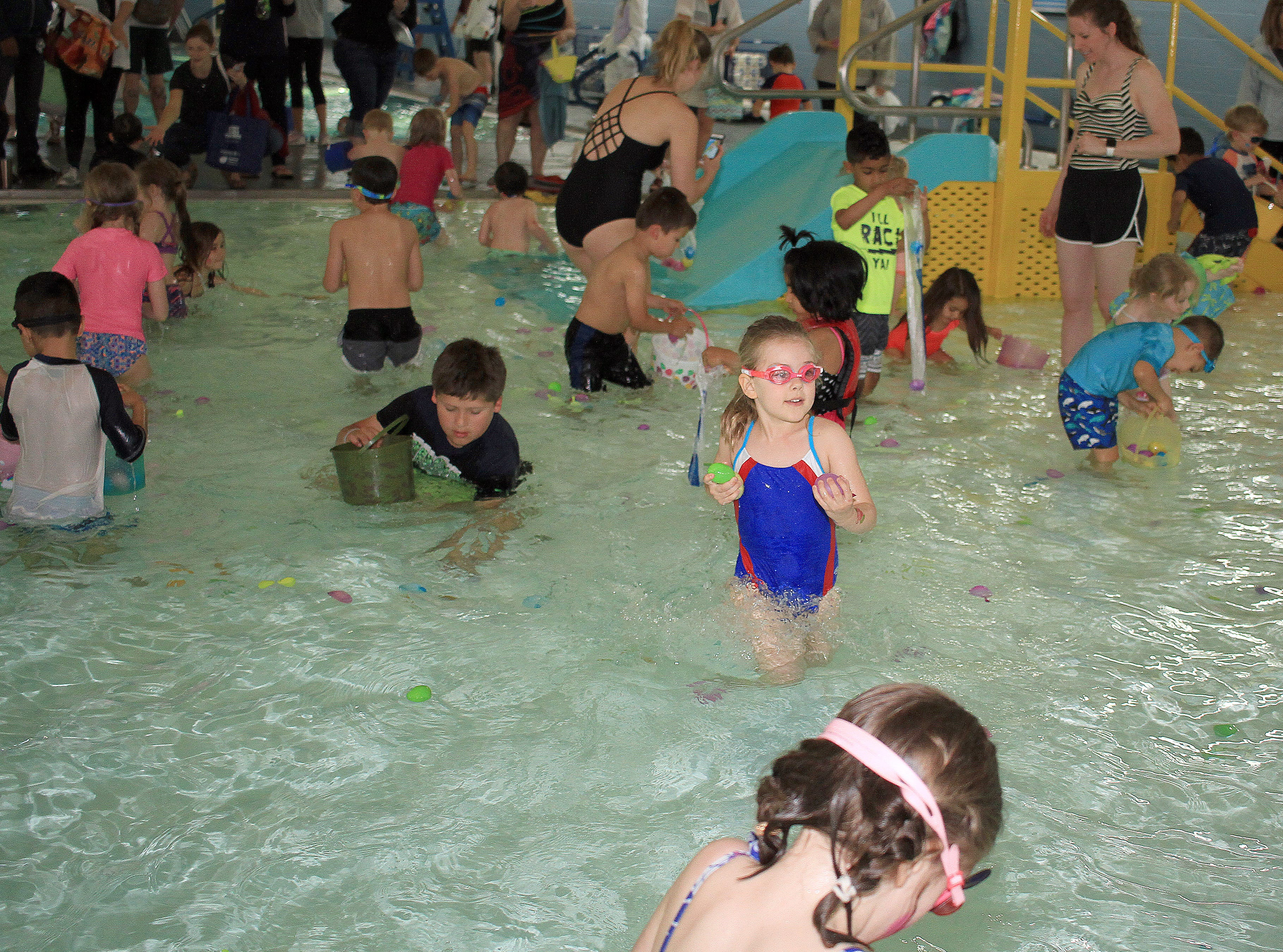 Kids hunt and dive for easter eggs at the Egg Dive at the Sumner County YMCA in Hendersonville, TN on Saturday, April 13, 2019.