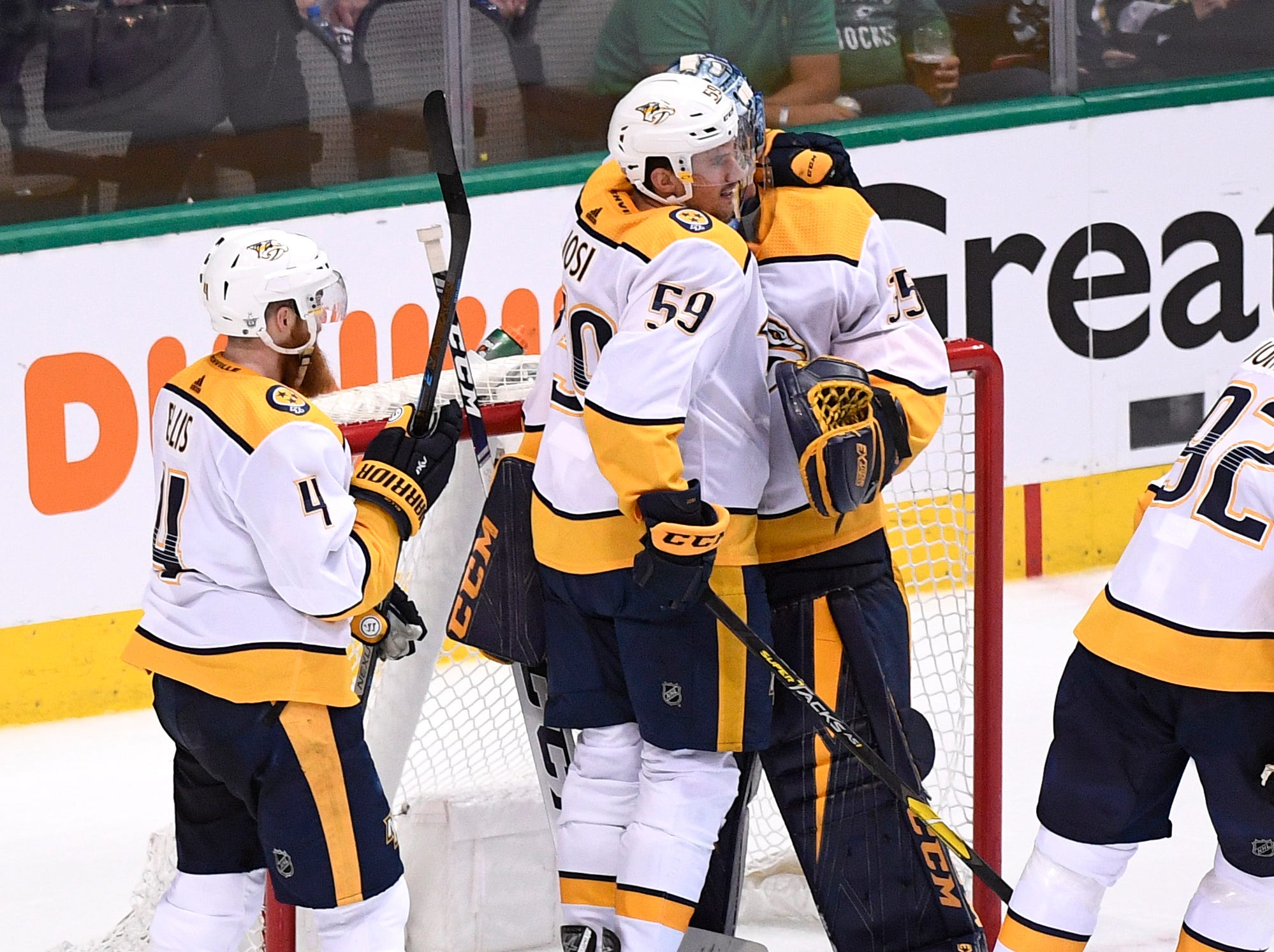 Nashville Predators defenseman Roman Josi (59) celebrates the win over the Dallas Stars with goaltender Pekka Rinne (35) in the divisional semifinal game at the American Airlines Center in Dallas, Texas., Monday, April 15, 2019.