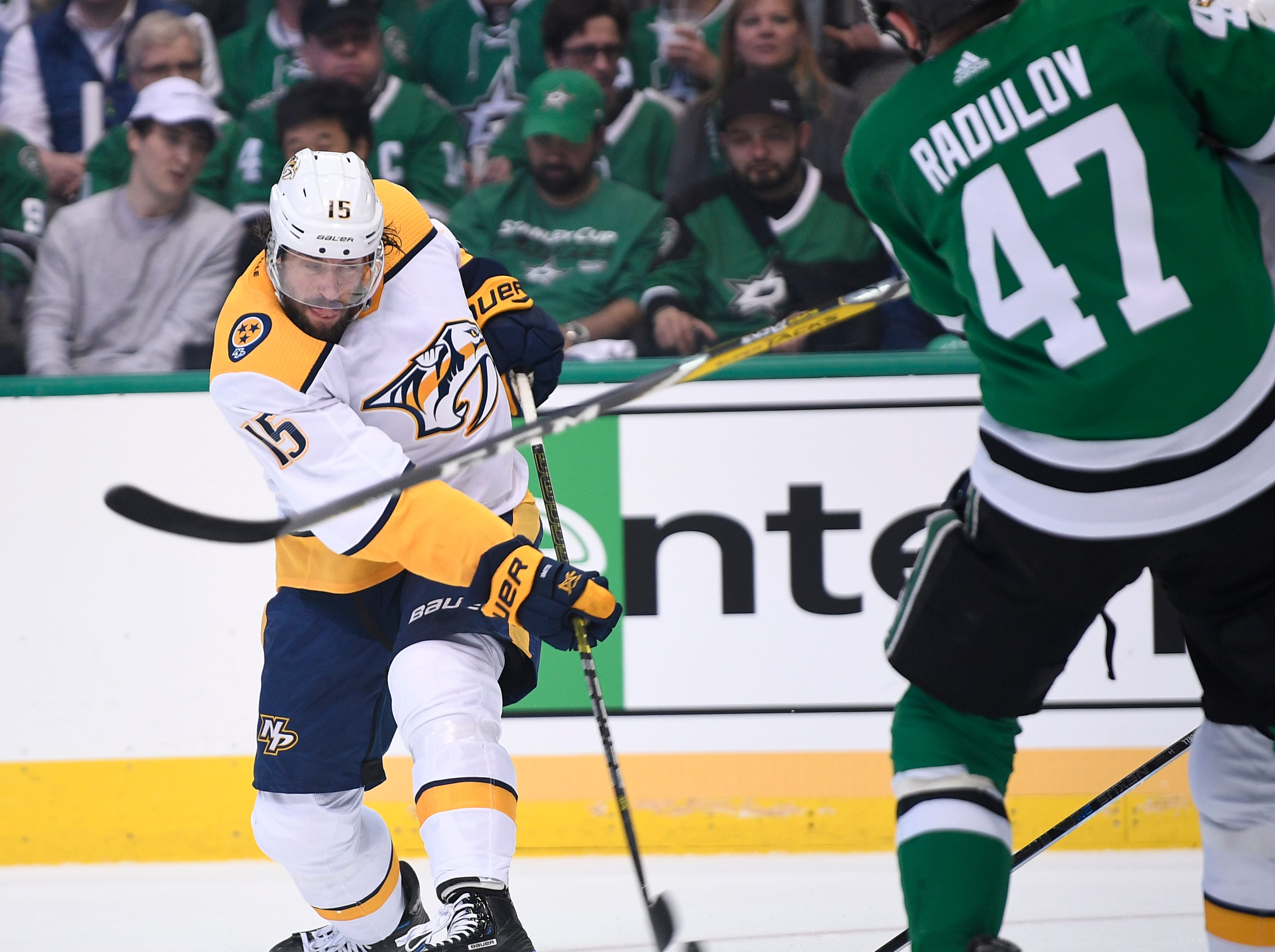 Nashville Predators right wing Craig Smith (15) moves the puck defended by Dallas Stars right wing Alexander Radulov (47) during the first period of the divisional semifinal game at the American Airlines Center in Dallas, Texas., Monday, April 15, 2019.