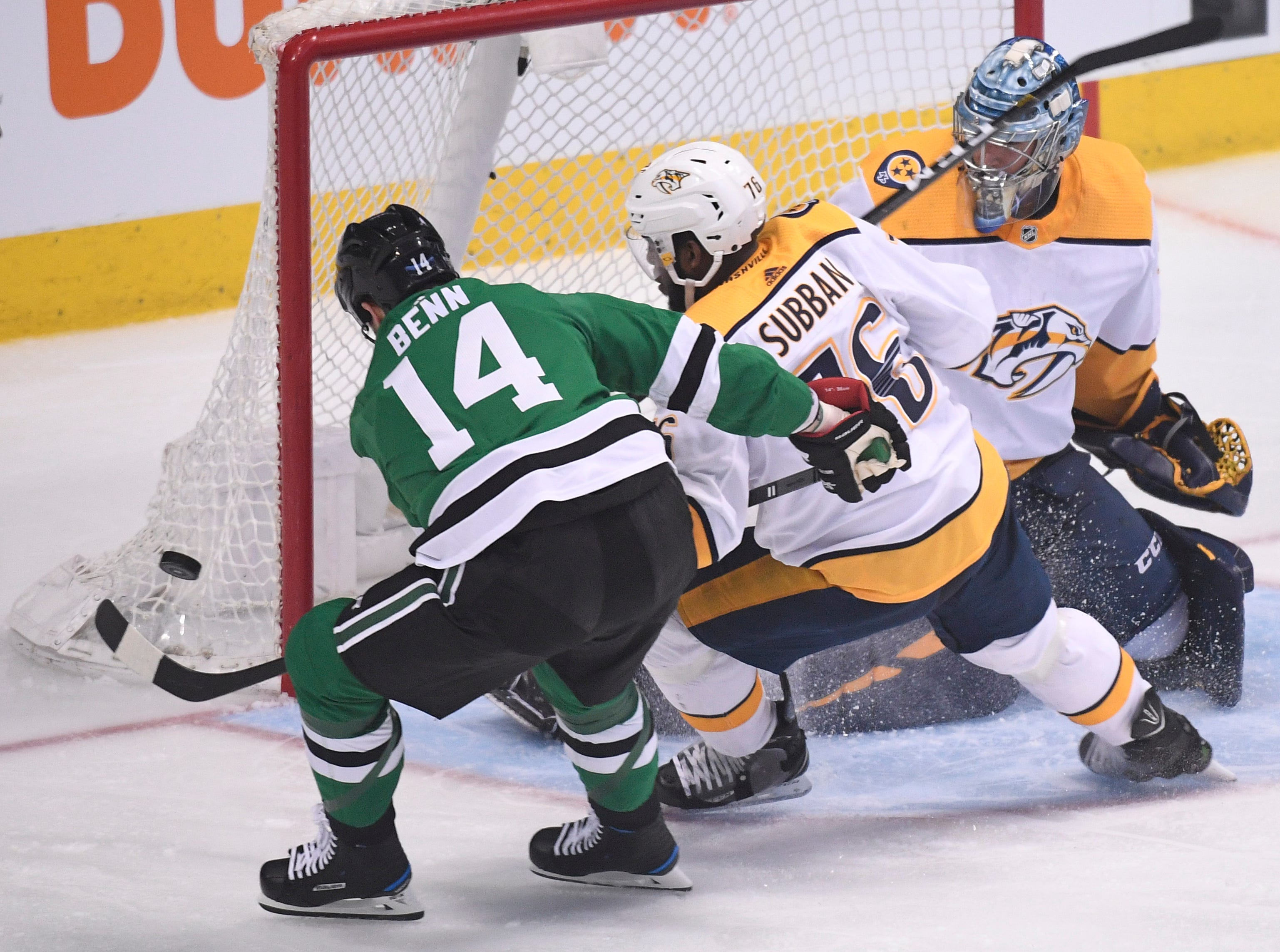 Dallas Stars left wing Jamie Benn (14) shoots wide of the net defended by Nashville Predators goaltender Pekka Rinne (35) and defenseman P.K. Subban (76) during the third period of the divisional semifinal game at the American Airlines Center in Dallas, Texas., Monday, April 15, 2019.