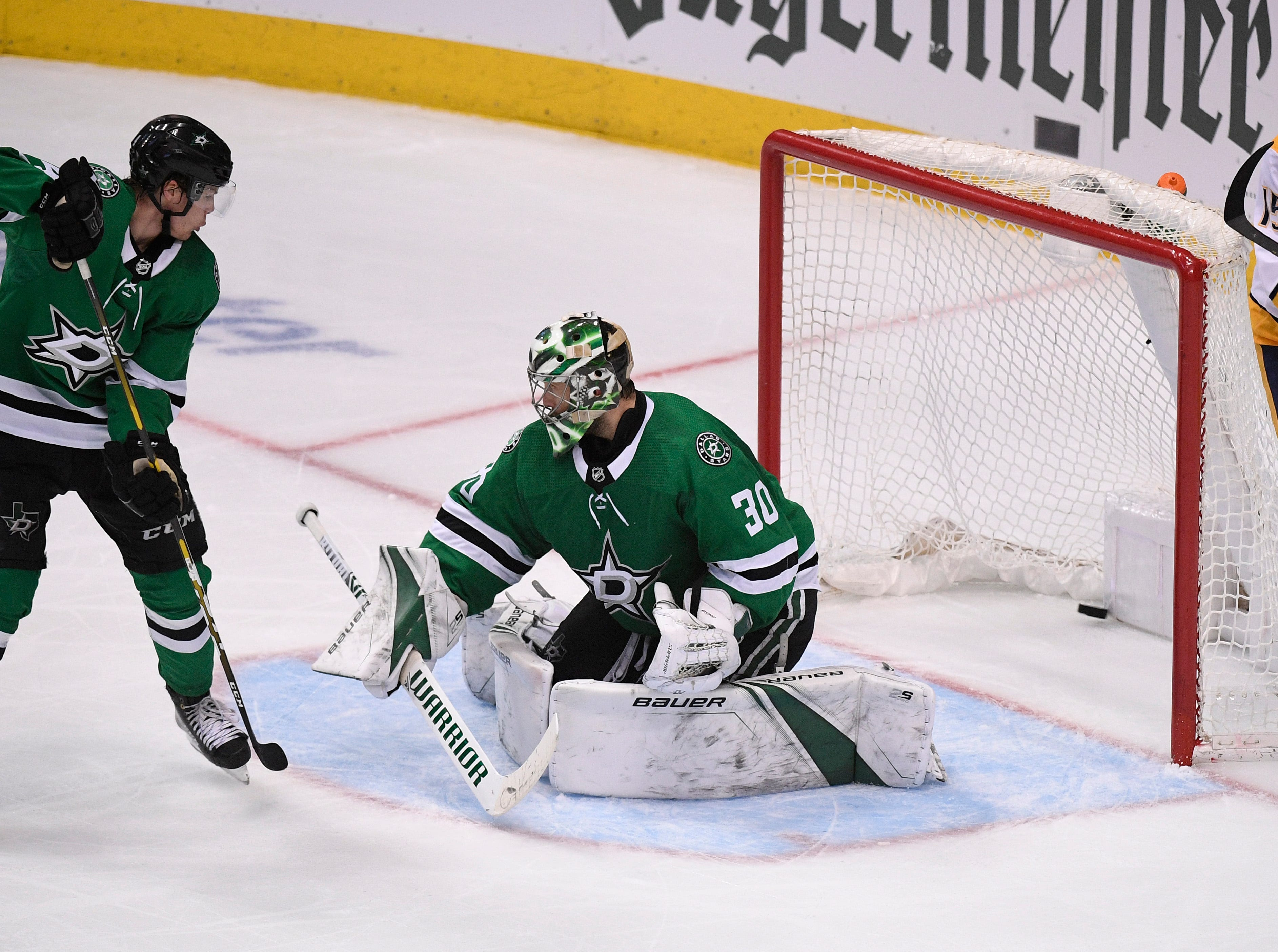 The game-winning goal by Nashville Predators center Mikael Granlund (64) gets past Dallas Stars goaltender Ben Bishop (30) during the third period of the divisional semifinal game at the American Airlines Center in Dallas, Texas., Monday, April 15, 2019.