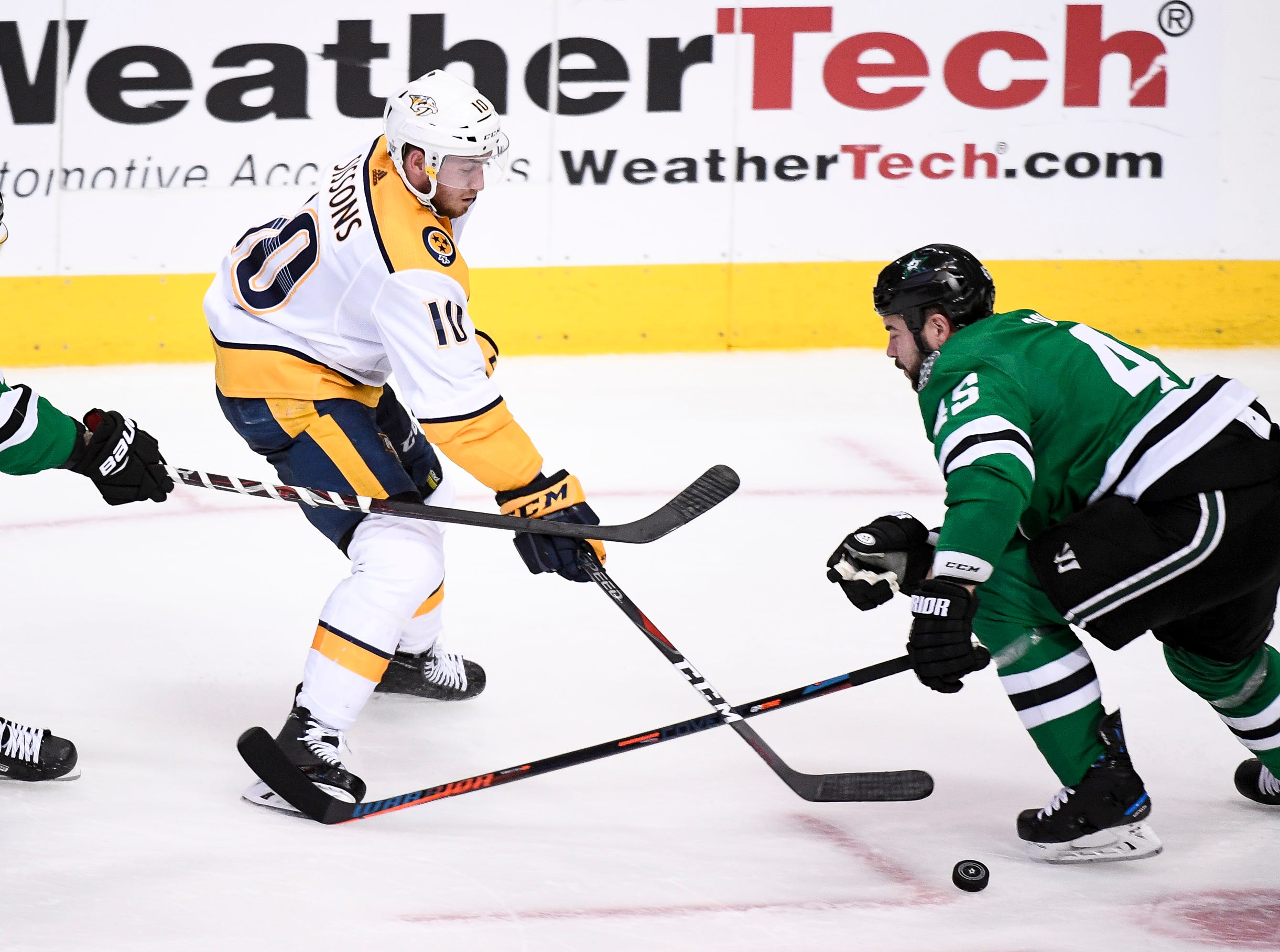 Nashville Predators center Colton Sissons (10) skates through Dallas Stars center Tyler Seguin (91) and defenseman Roman Polak (45) during the third period of the divisional semifinal game at the American Airlines Center in Dallas, Texas., Monday, April 15, 2019.