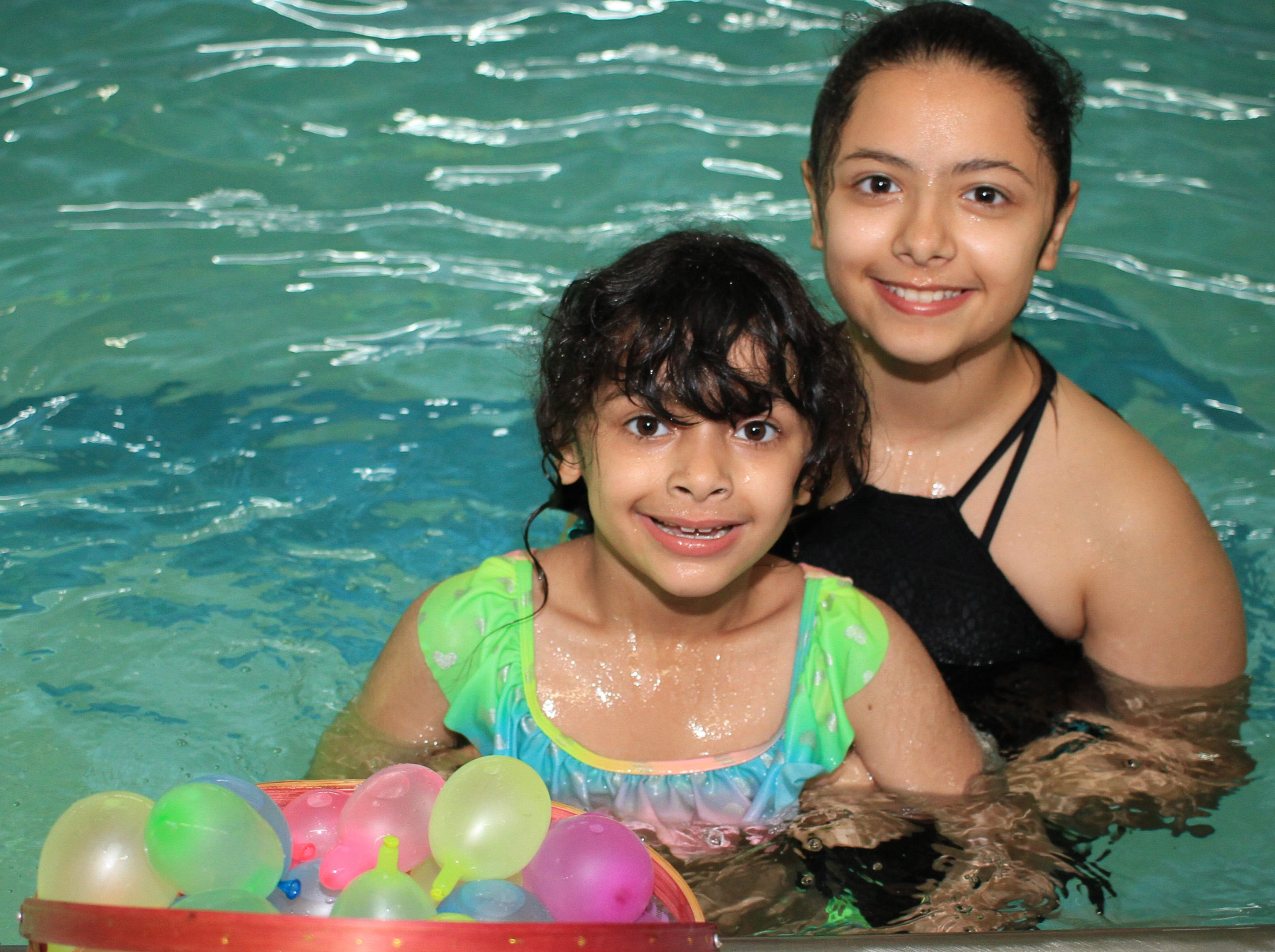 Hanta and Hasti Saadatyar dove for a full basket of eggs at the Sumner County YMCA Egg Dive in Hendersonville, TN on Saturday, April 13, 2019.