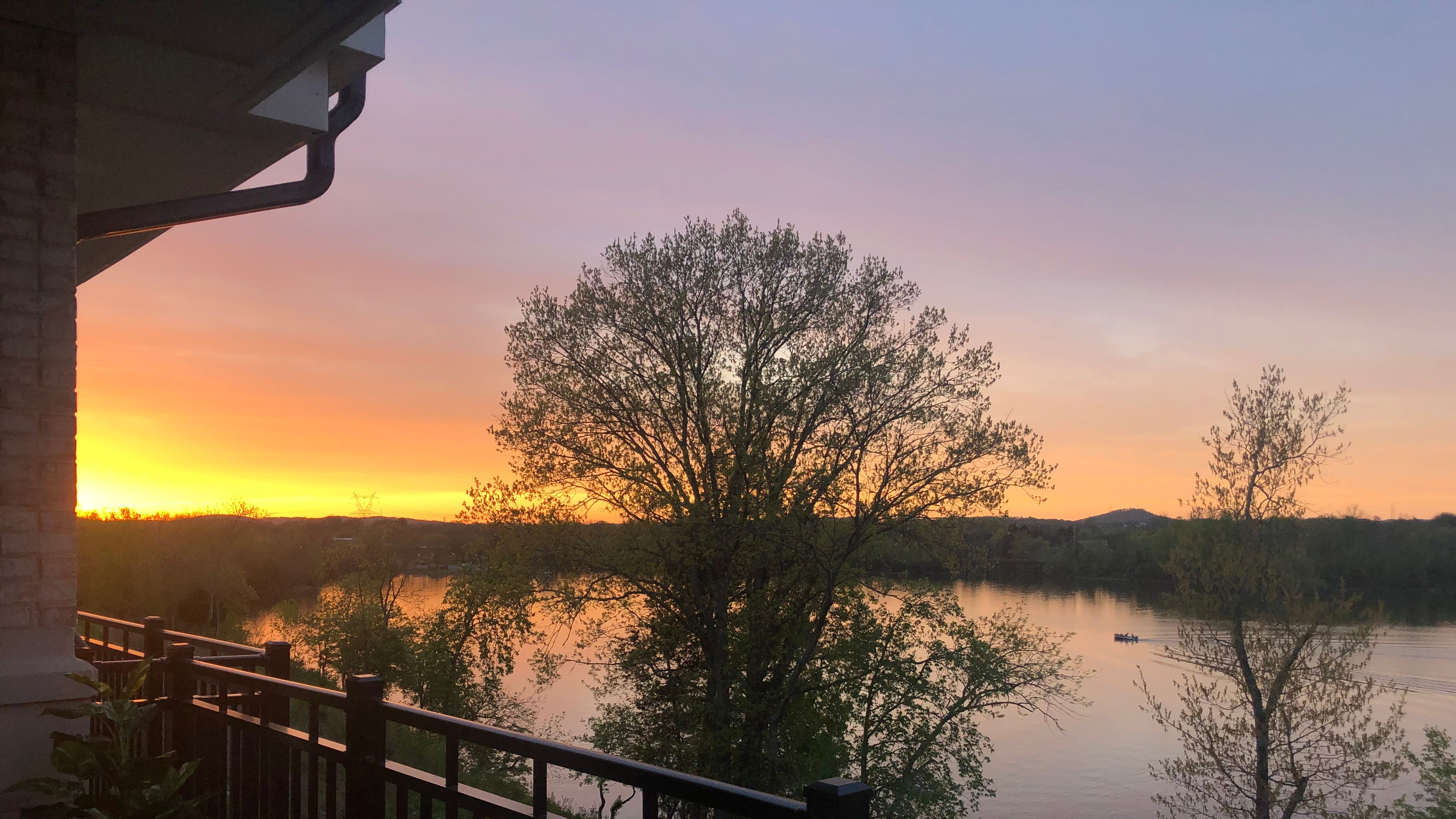 Sunset at Revery Point, the new luxury condos on Old Hickory Lake, located 25 minutes outside of Nashville in the Foxland Harbor country club community.