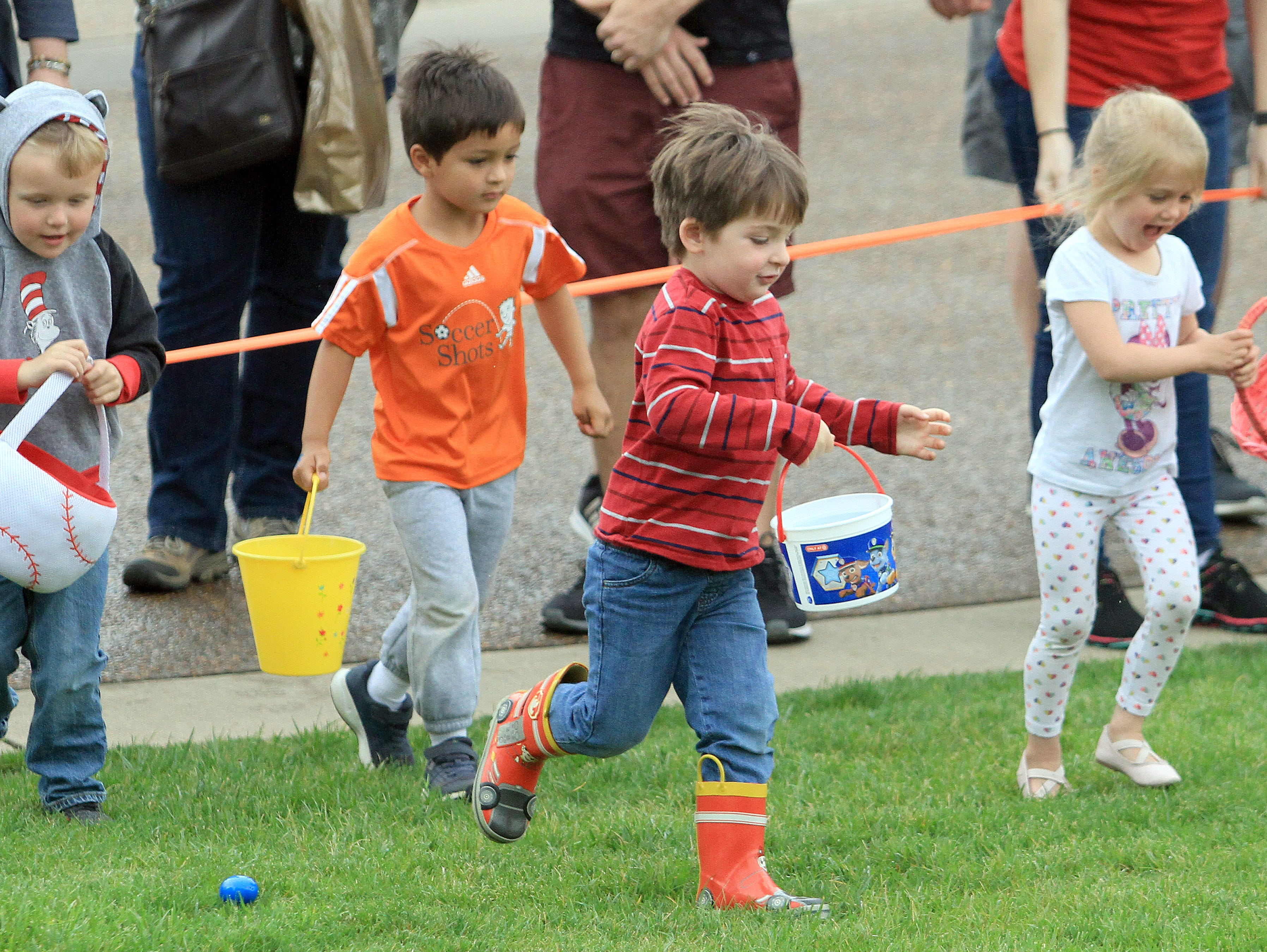Kids run for their eggs at the Sumner County YMCA egg hunt in Hendersonville, TN on Saturday, April 13, 2019.