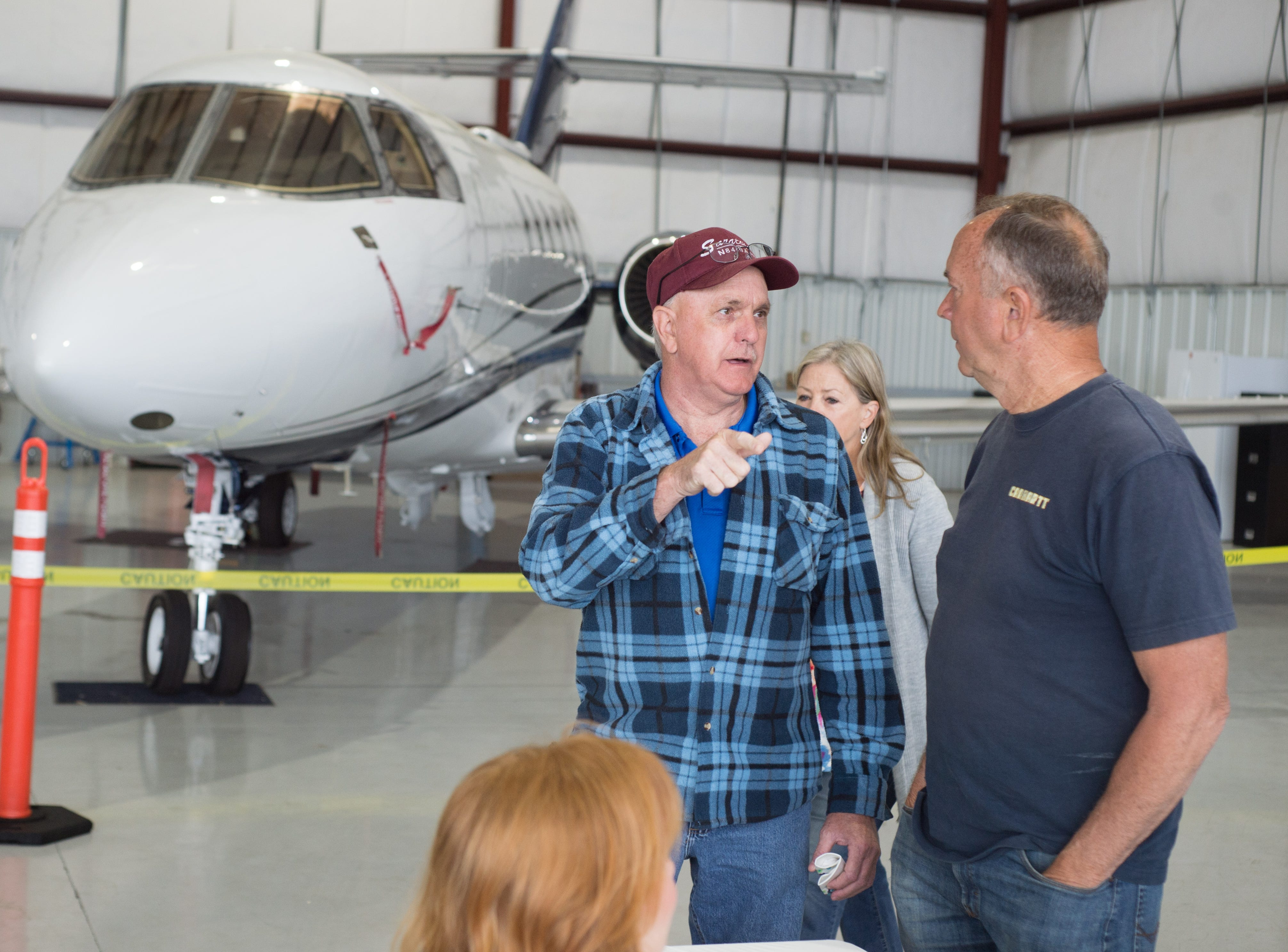 Attendees chat during a Fly-In Breakfast at the Sumner County Regional Airport in Gallatin on Saturday, April 13.