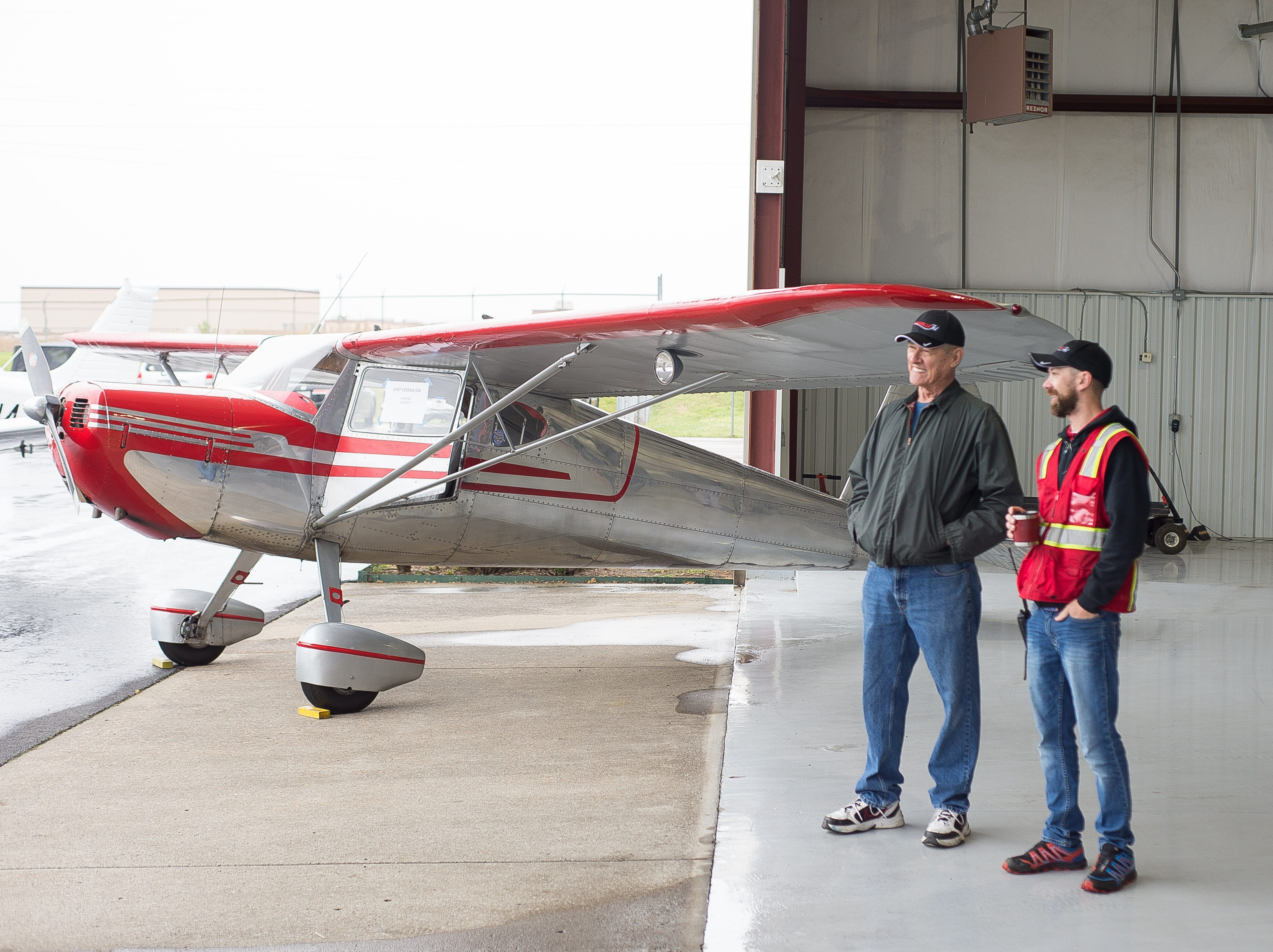 Skip Brooks and Jeff Dunham, General Manager at Nashville Jet, chat during a Fly-In Breakfast at the Sumner County Regional Airport in Gallatin on Saturday, April 13.