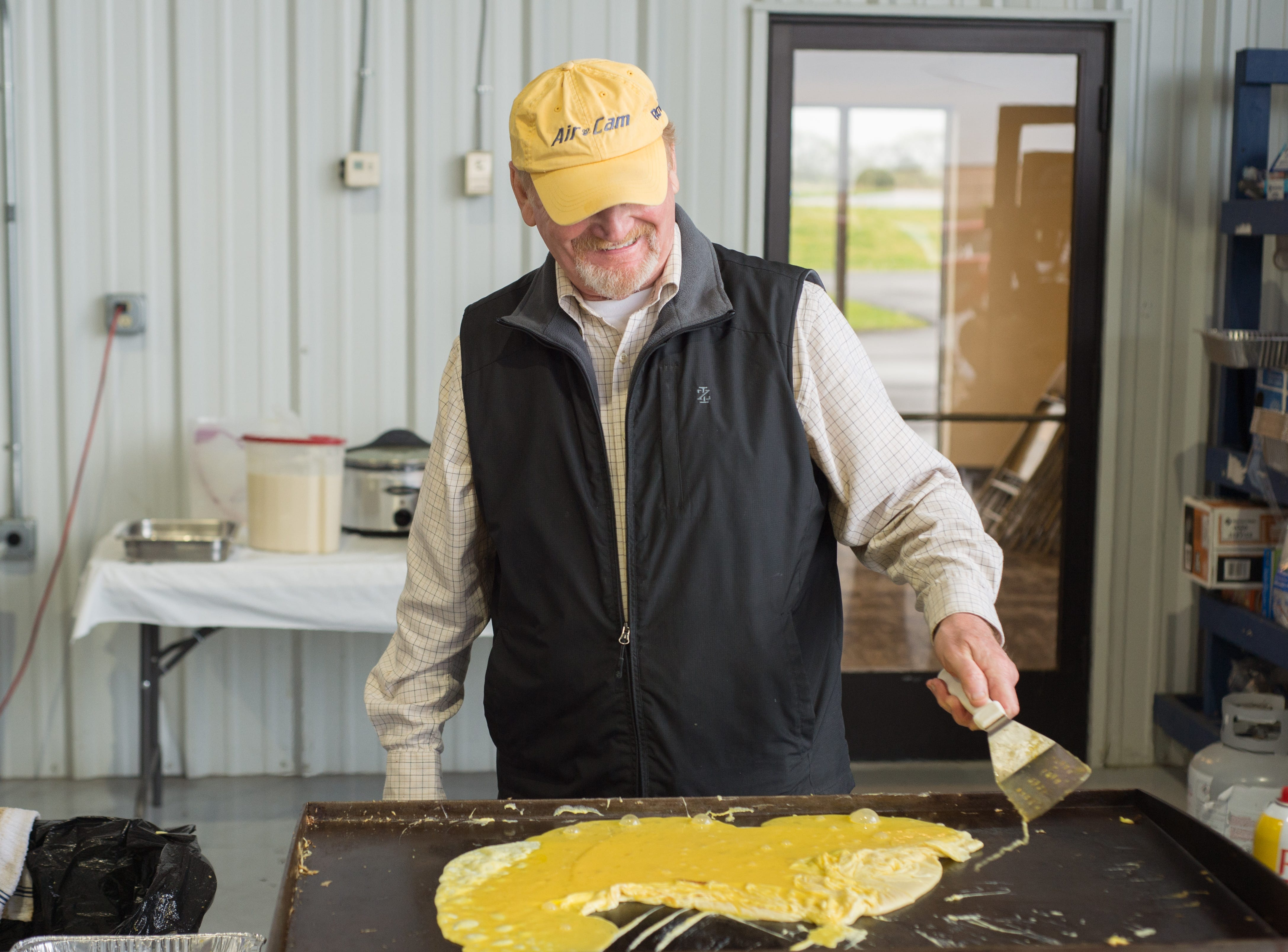 Jim Johnson helps make a delicious breakfast during a Fly-In Breakfast at the Sumner County Regional Airport in Gallatin on Saturday, April 13.