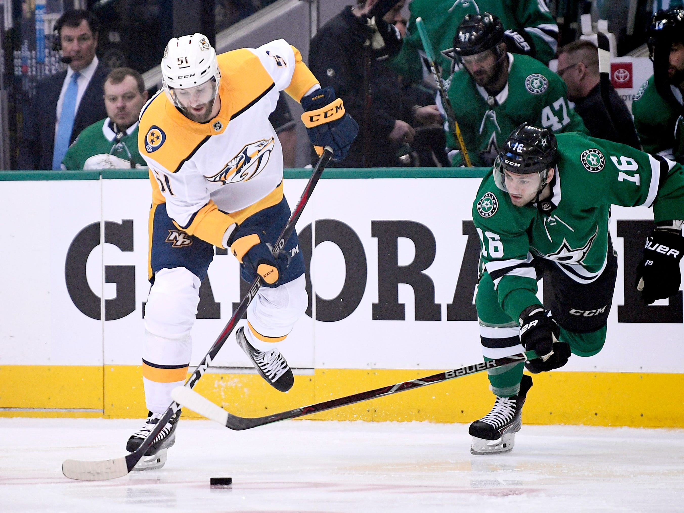 Nashville Predators left wing Austin Watson (51) moves the puck defended by Dallas Stars center Jason Dickinson (16) during the first period of the divisional semifinal game at the American Airlines Center in Dallas, Texas., Monday, April 15, 2019.
