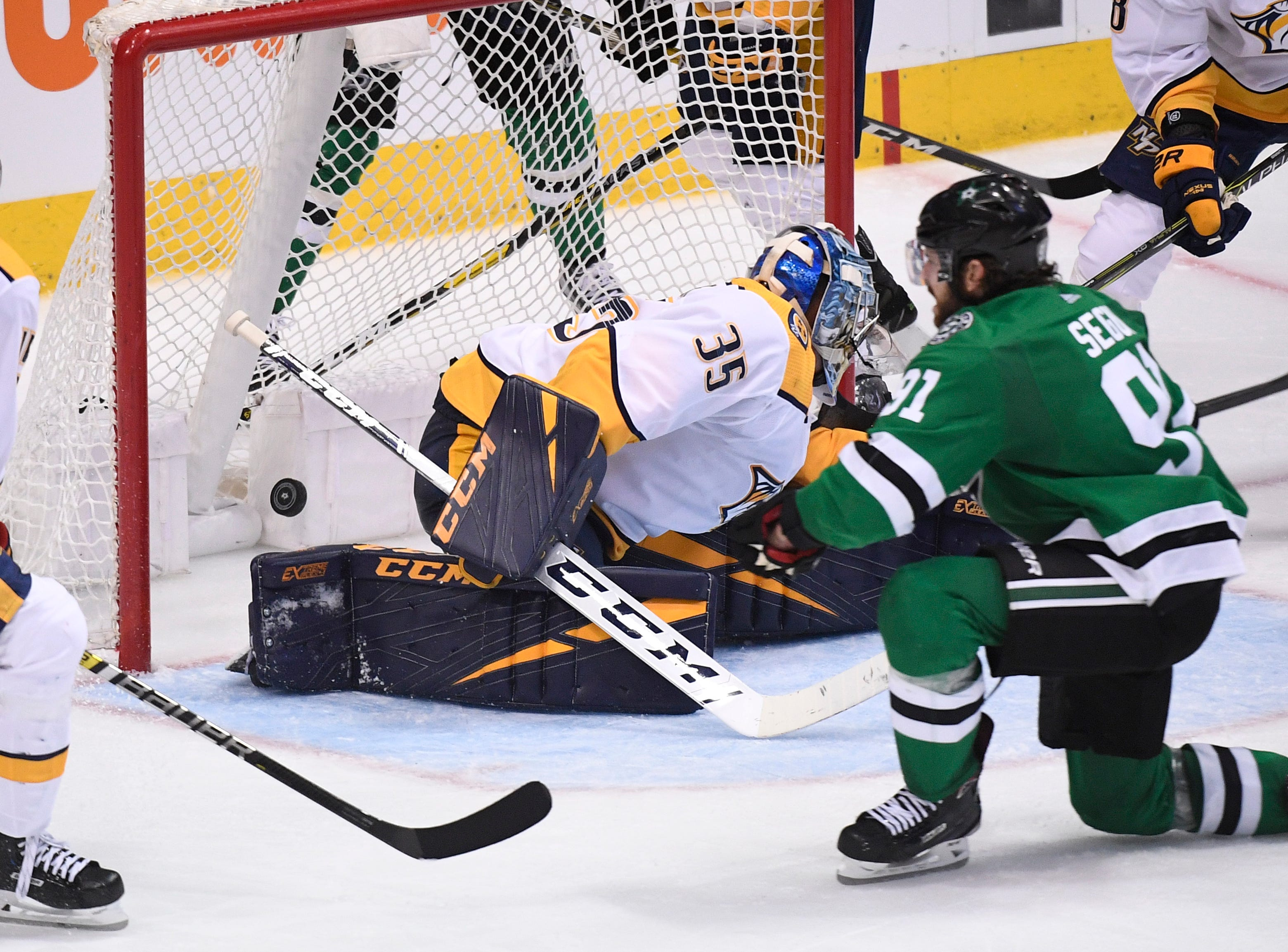 Dallas Stars center Tyler Seguin (91) watches his goal get past Nashville Predators goaltender Pekka Rinne (35) during the third period of the divisional semifinal game at the American Airlines Center in Dallas, Texas., Monday, April 15, 2019.