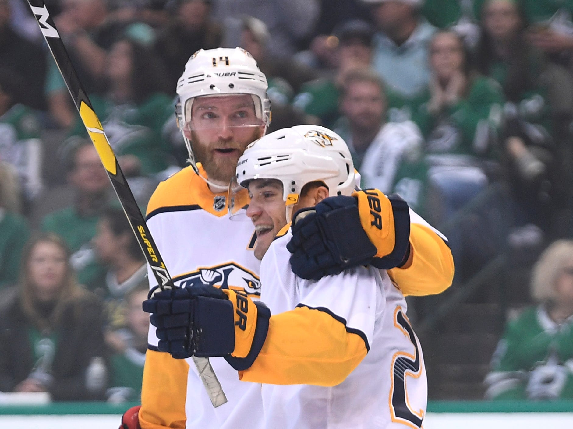 Nashville Predators center Rocco Grimaldi (23) celebrates his goal with defenseman Mattias Ekholm (14) during the second period of the divisional semifinal game at the American Airlines Center in Dallas, Texas., Monday, April 15, 2019.