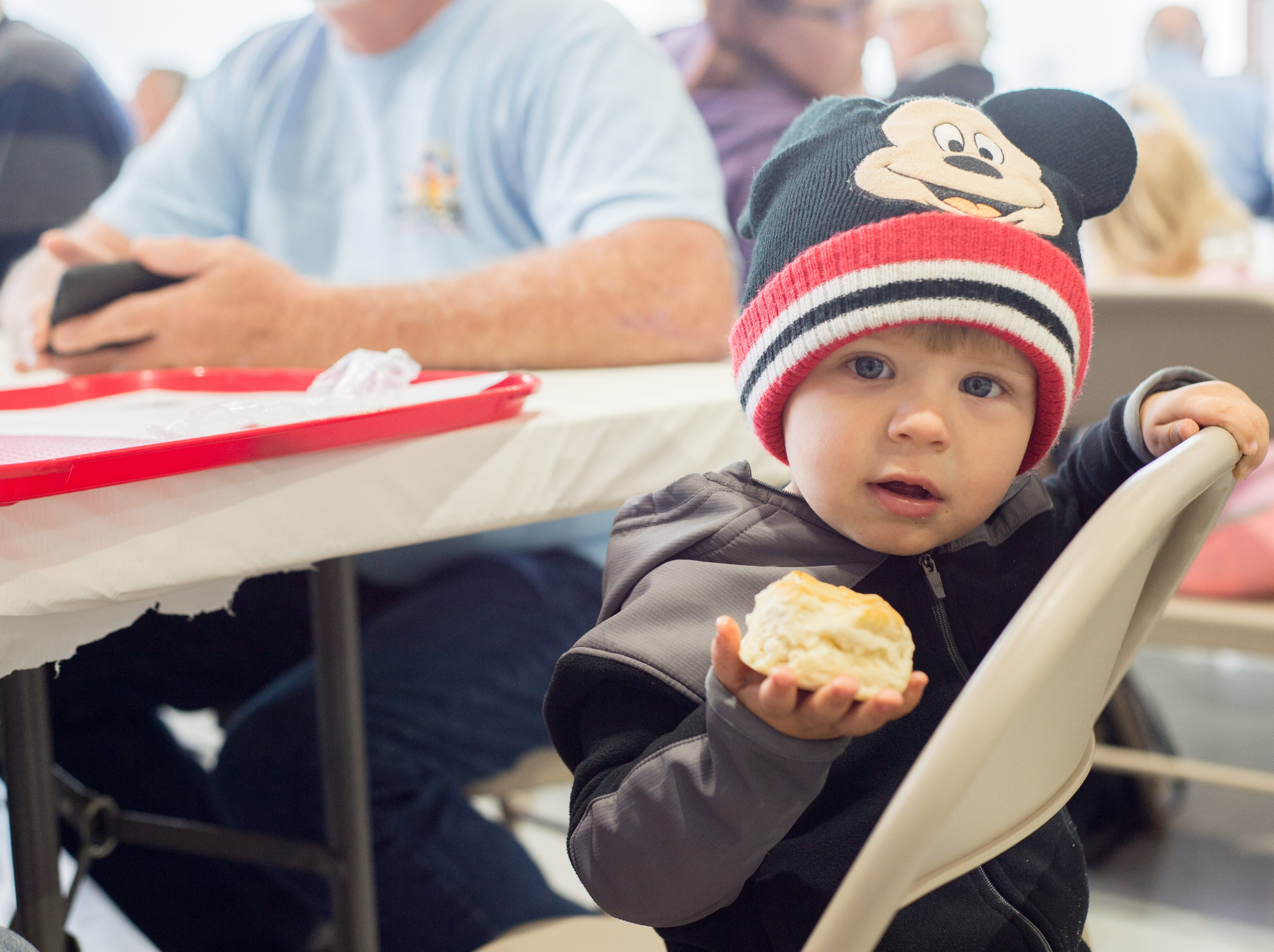Trey Kowalski enjoys a biscuit during a Fly-In Breakfast at the Sumner County Regional Airport in Gallatin on Saturday, April 13.