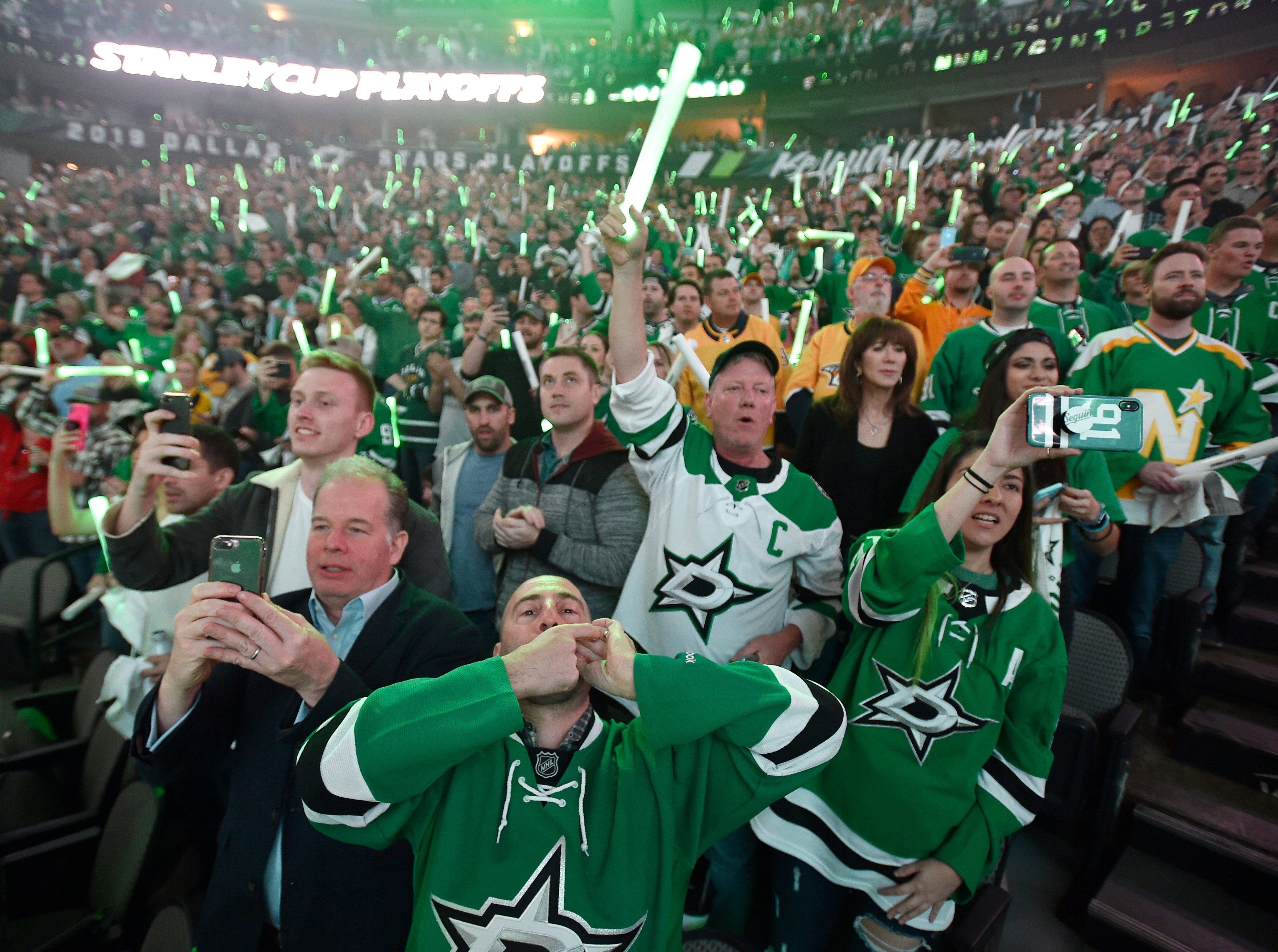 Stars fans cheer at the start of the divisional semifinal game  against the Predators at the American Airlines Center in Dallas, Texas., Monday, April 15, 2019.