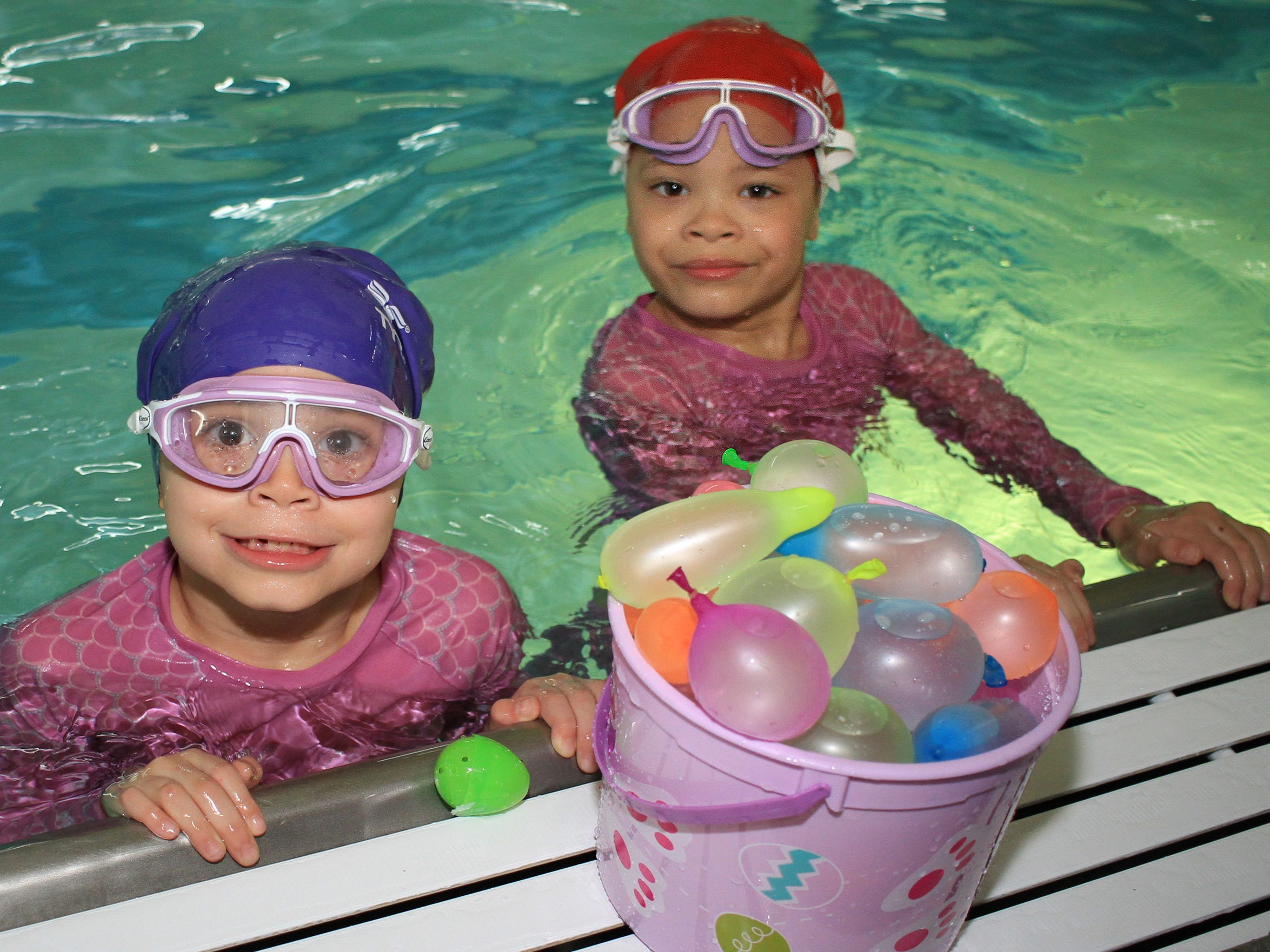 Twins Peyton and Cameron Boyn (6) gather their eggs at The Easter Egg Dive at the Sumner County YMCA in Hendersonville, TN on Saturday, April 13, 2019.