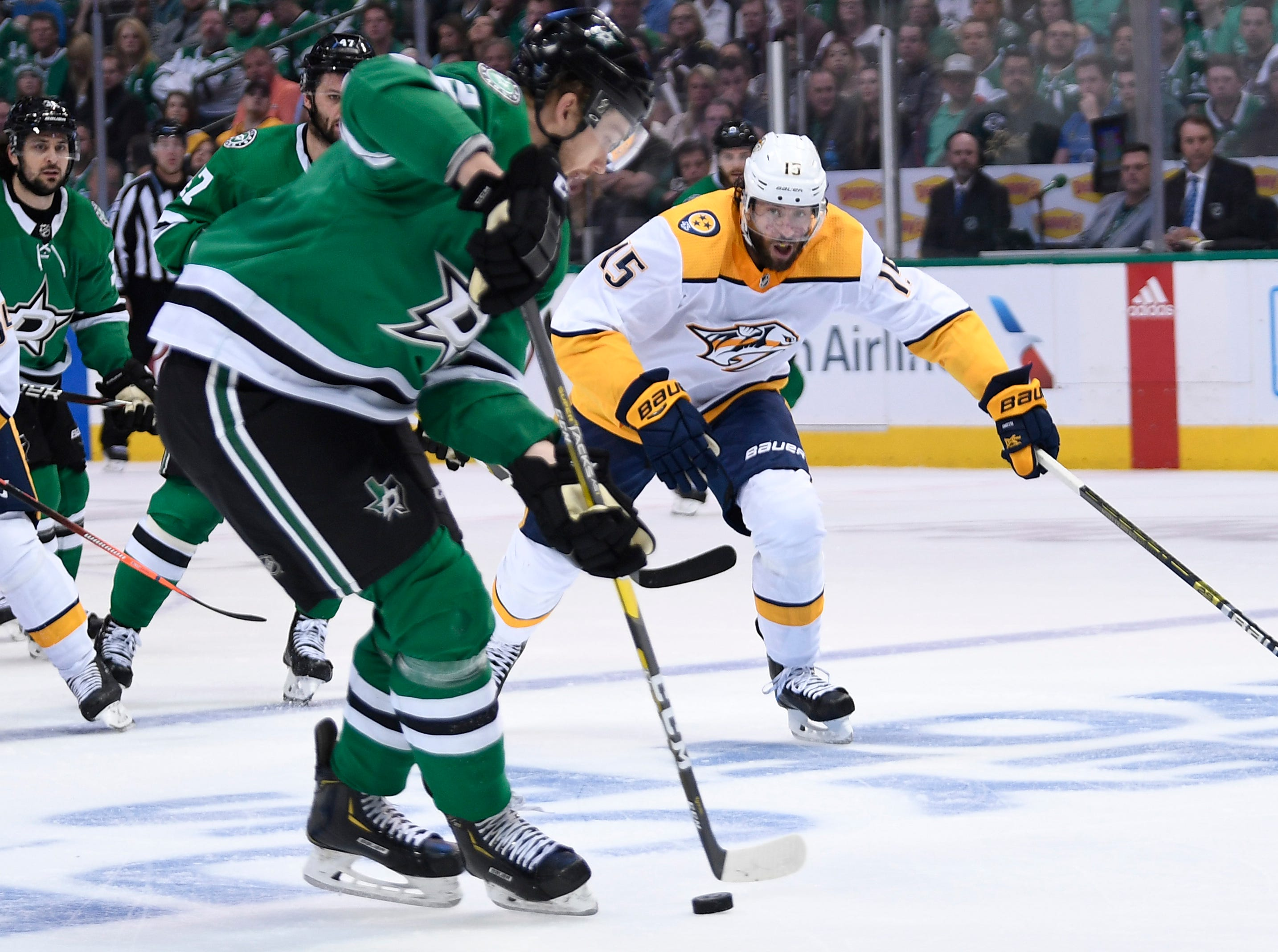 Nashville Predators right wing Craig Smith (15) chases after Dallas Stars defenseman Jamie Oleksiak (2) during the second period of the divisional semifinal game at the American Airlines Center in Dallas, Texas., Monday, April 15, 2019.