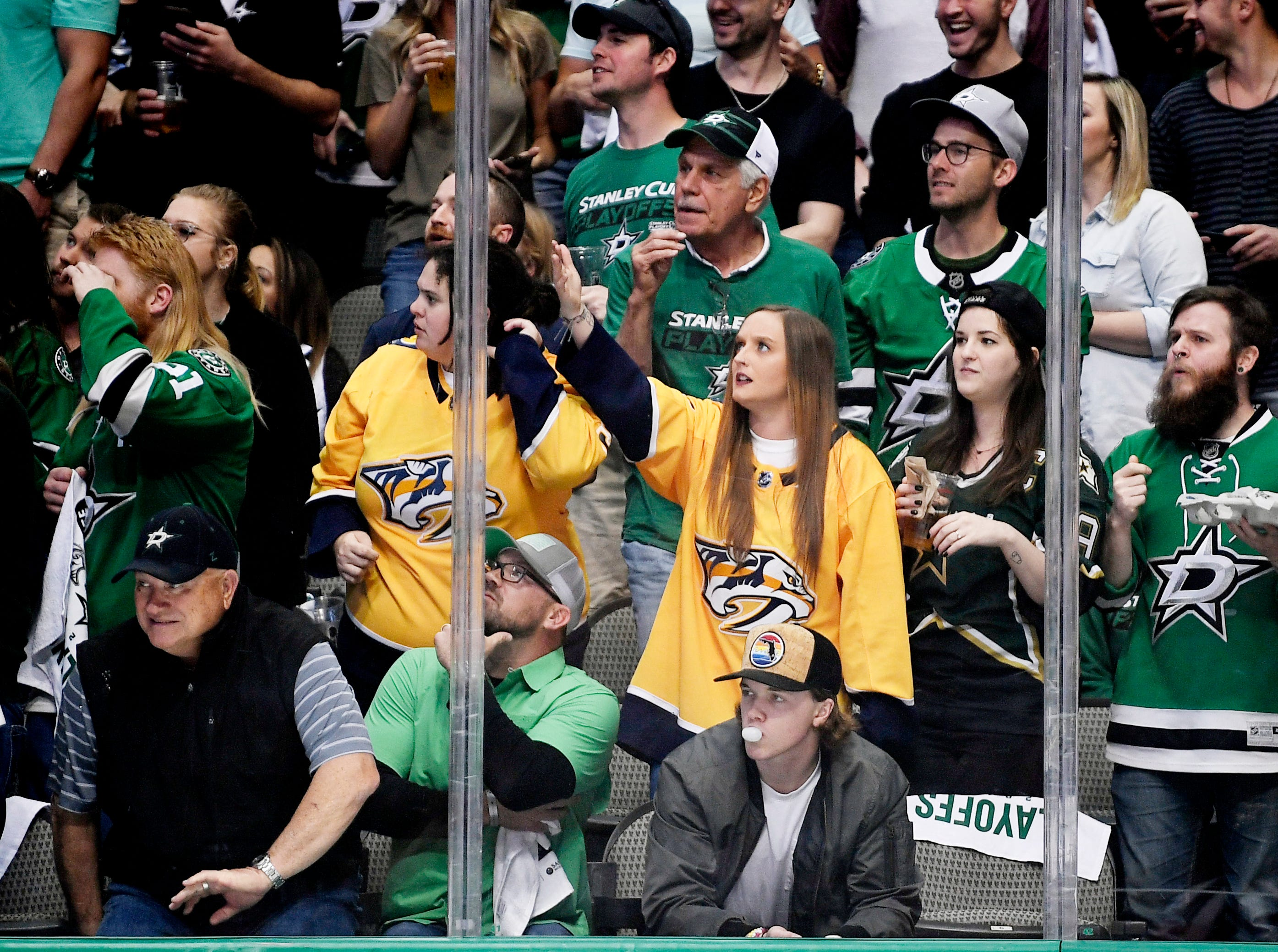 Predators and Stars fans watch the action during the first period of the divisional semifinal game at the American Airlines Center in Dallas, Texas., Monday, April 15, 2019.