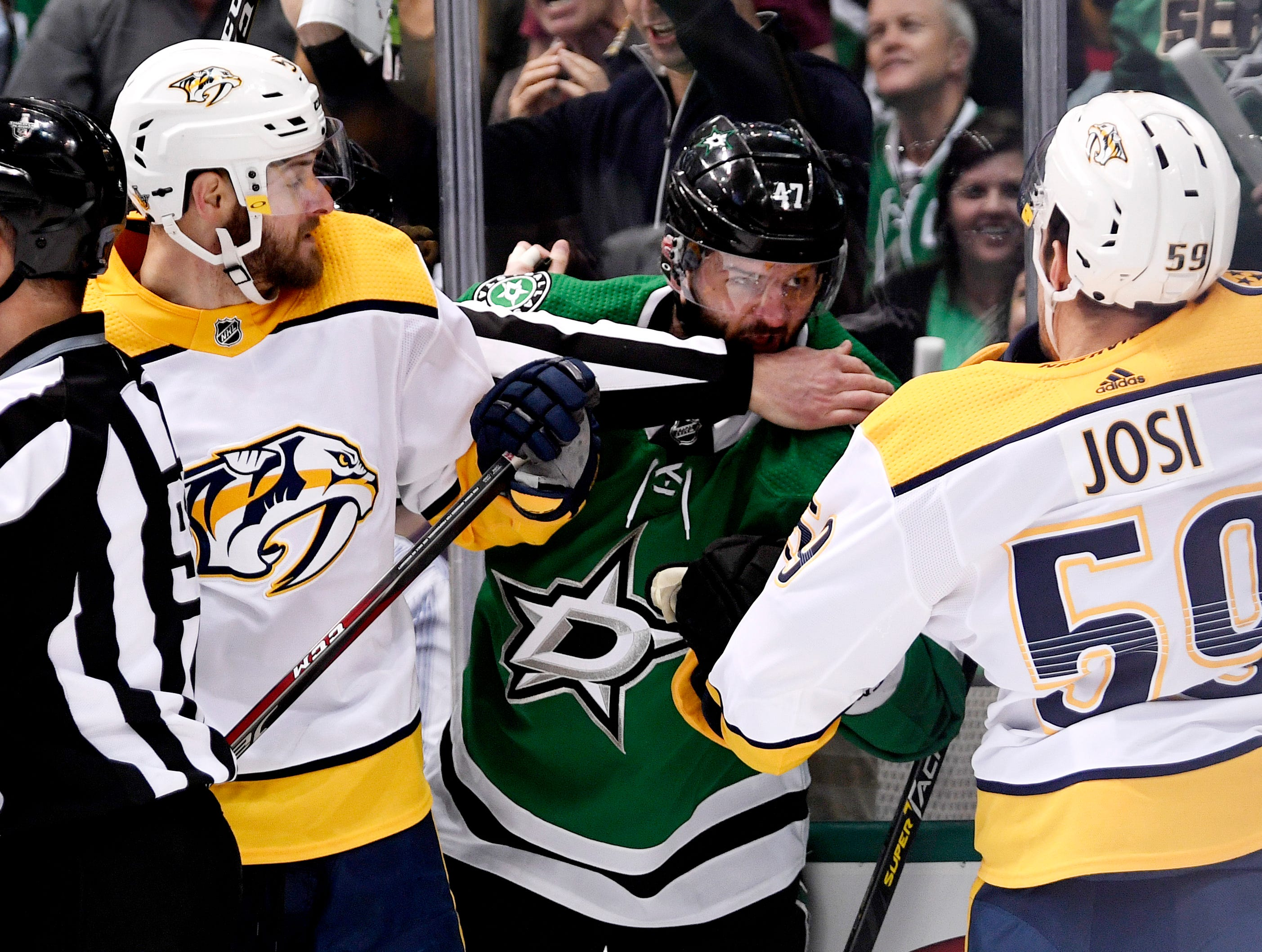 Nashville Predators left wing Austin Watson (51) and defenseman Roman Josi (59) fight Dallas Stars right wing Alexander Radulov (47) during the first period of the divisional semifinal game at the American Airlines Center in Dallas, Texas., Monday, April 15, 2019.