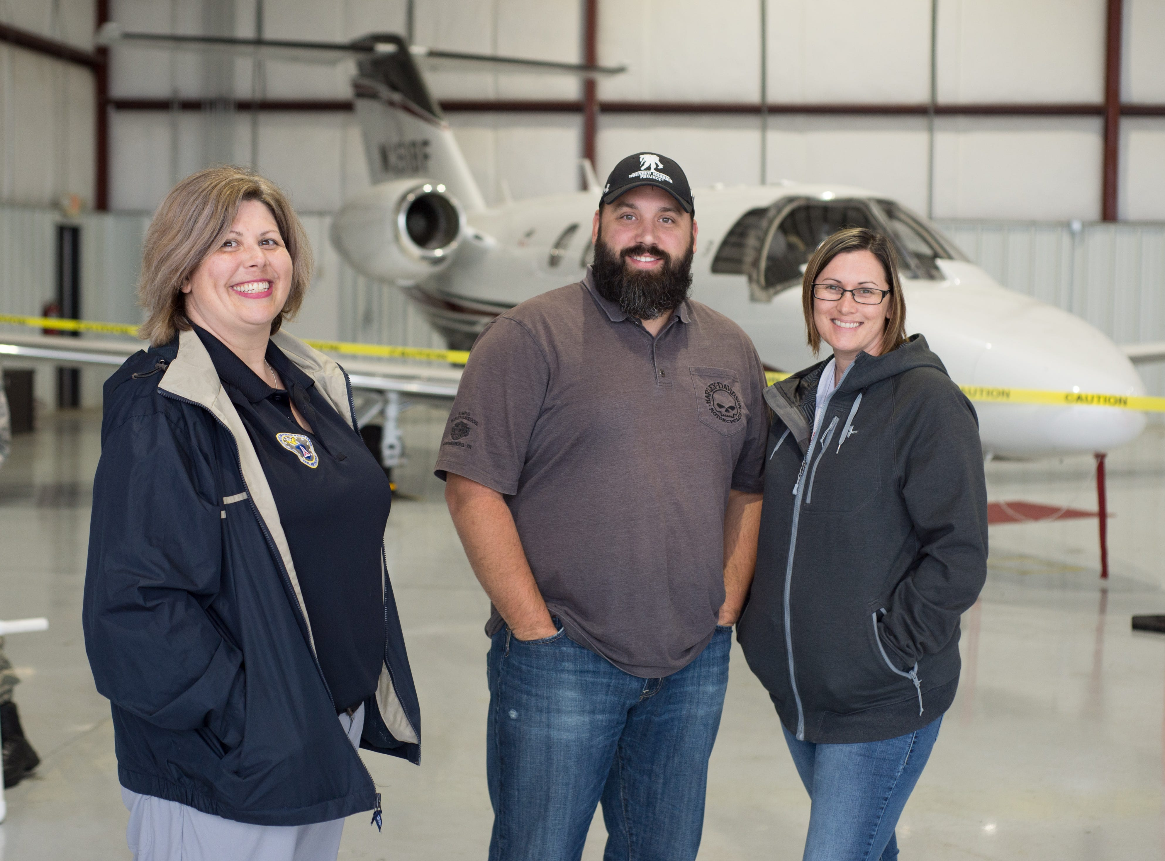 Tracy Loftis, Bryan and Holly Eaton enjoy a Fly-In Breakfast at the Sumner County Regional Airport in Gallatin on Saturday, April 13.