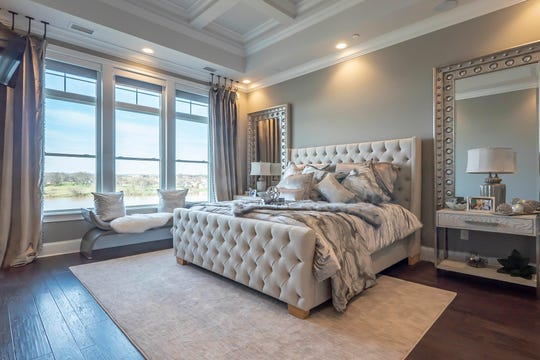 The master bedroom of the penthouse at Revery Point has a lakefront view. The  walls, floor and ceiling of each condo have additional sound proofing measures for privacy.