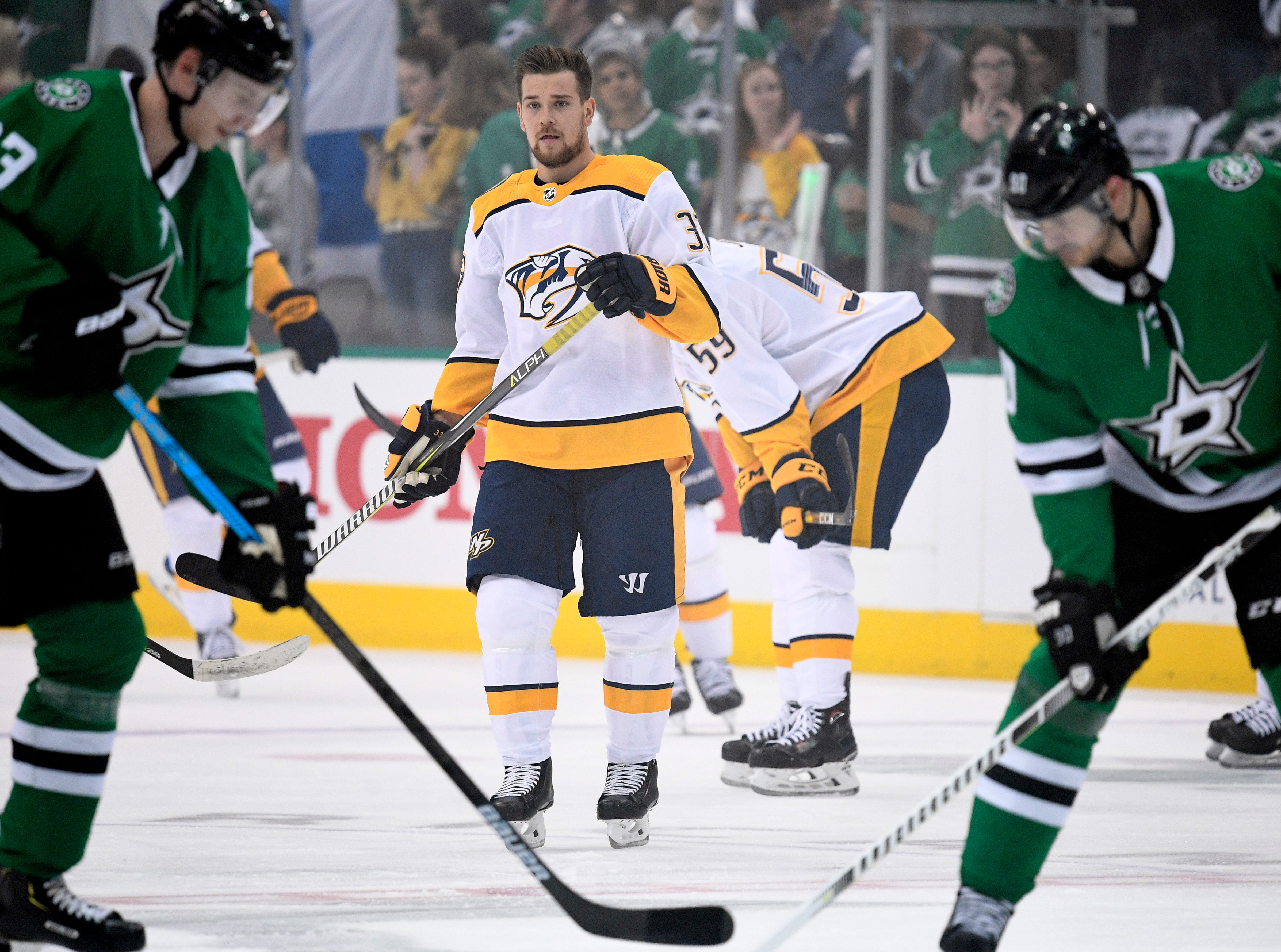 Nashville Predators right wing Viktor Arvidsson (33) warms up surrounded by  Stars players before the divisional semifinal game at the American Airlines Center in Dallas, Texas., Monday, April 15, 2019.