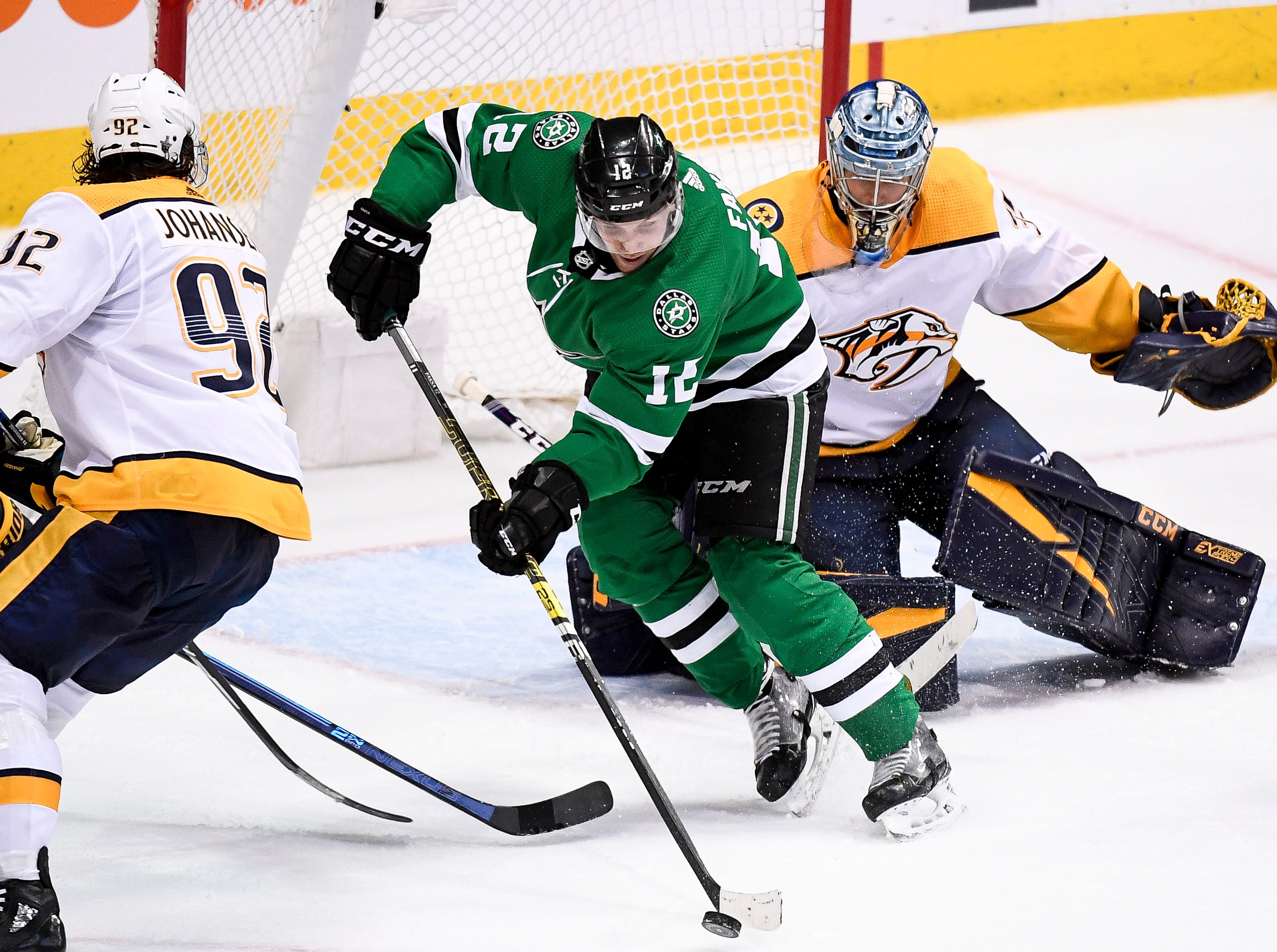 Dallas Stars center Radek Faksa (12) battles Nashville Predators center Ryan Johansen (92) and goaltender Pekka Rinne (35) during the third period of the divisional semifinal game at the American Airlines Center in Dallas, Texas., Monday, April 15, 2019.