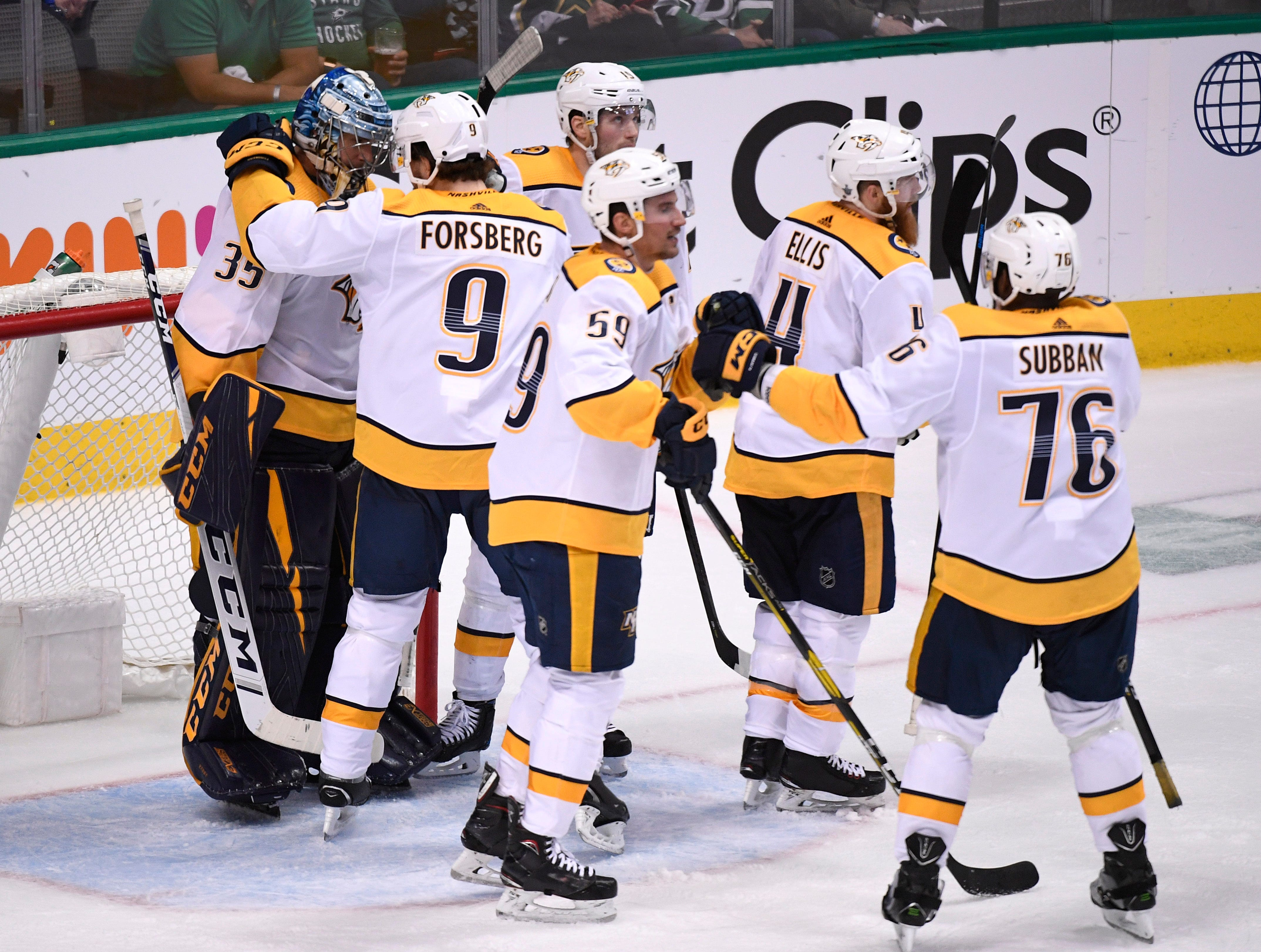 The Predators celebrate the win over the Dallas Stars with goaltender Pekka Rinne (35) in the divisional semifinal game at the American Airlines Center in Dallas, Texas., Monday, April 15, 2019.