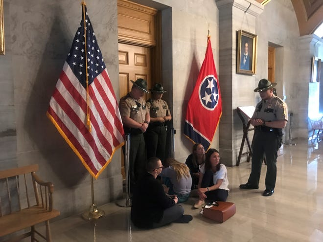 Protesters sit outside of Gov. Bill Lee's office on April 16, 2019.