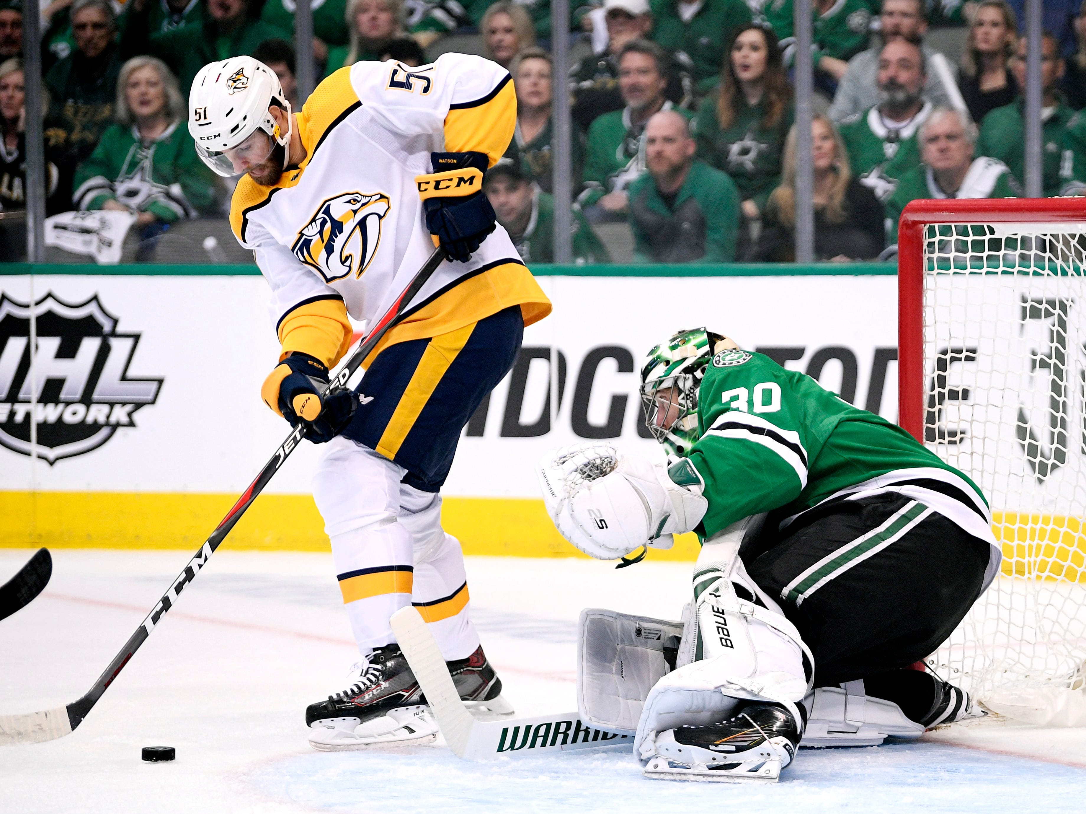 Nashville Predators left wing Austin Watson (51) plays the puck in front of Dallas Stars goaltender Ben Bishop (30) during the first period of the divisional semifinal game at the American Airlines Center in Dallas, Texas., Monday, April 15, 2019.