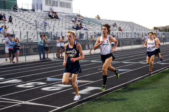 Brady Gibson of Naples High School sets the pace at the boys 3200 during the Class 3A-District 12 track and field meet at Palmetto Ridge High School in Naples, Fla., on Monday, April 15th, 2019.