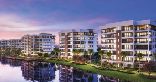 All of the residences at Moorings Park Grande Lake overlook a large lake with a golf course beyond.