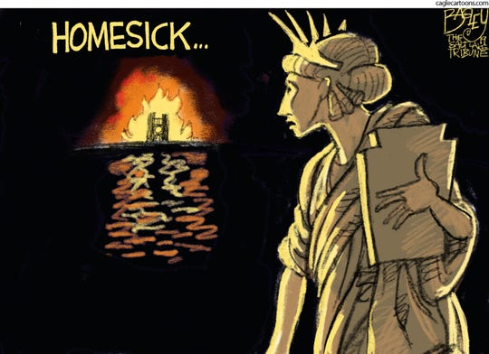 lady liberty looks back at ND fire