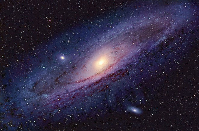 """The Great Andromeda Galaxy,"" M31, shown here, and our own galaxy, the Milky Way, are traveling through space towards each other at a speed of 216,000 miles per hour. The coming collision will be the biggest event in our region of space in eons."
