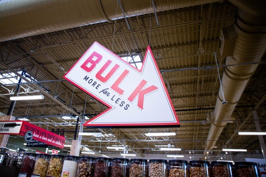 A sign points to the bulk items available for purchase at Lucky's Market on the day of their soft opening in North Naples on Tuesday, April 16, 2019.
