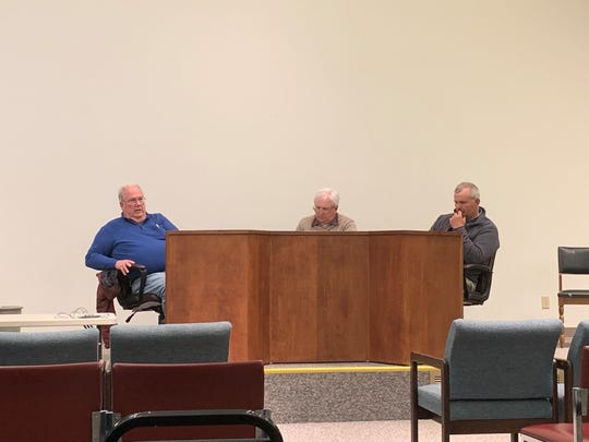 Union Township Trustees Charlie Prince, Randy Weekly, and John Slater listen to the public's comments and questions regarding a possible fire district between Hebron and the township at a regular meeting on Monday, April 15, 2019.