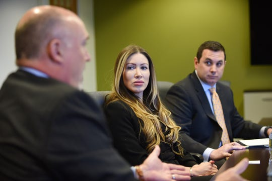 Yoly Parra (C), Owner of Fashionable Pets in the Garden State Plaza and a member of the Coalition of Responsible Pet Store Owners and Thomas Leech (R), Leech Policy Advisor, listen as Michael P. Turner (foreground) , President/ Managing member of Burton Trent, speaks during the Edit board meeting at The Record in Woodland Park on 04/16/19.