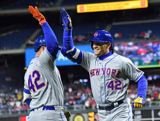 New York Mets center fielder Brandon Nimmo (right) hive fives New York Mets first baseman Pete Alonso after hitting a home run against the Philadelphia Phillies during the sixth inning at Citizens Bank Park.