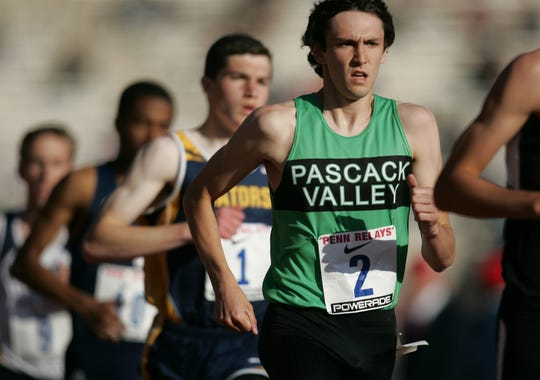 Ben Malone of Pascack Valley runs towards a personal record of 4:05.59 in the mile during a 2013 meet.