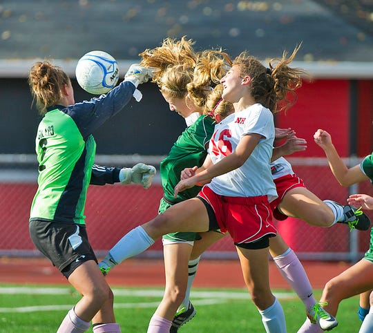 Clare Shea scores (on this header) the winning goal in a 2011 playoff game.