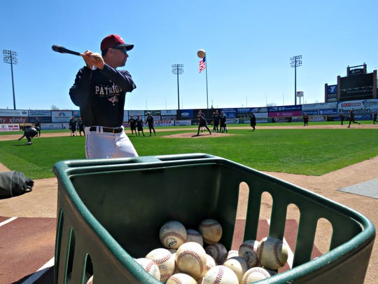 Patriots manager Brett Jodie hits ground balls during the first day of spring training.