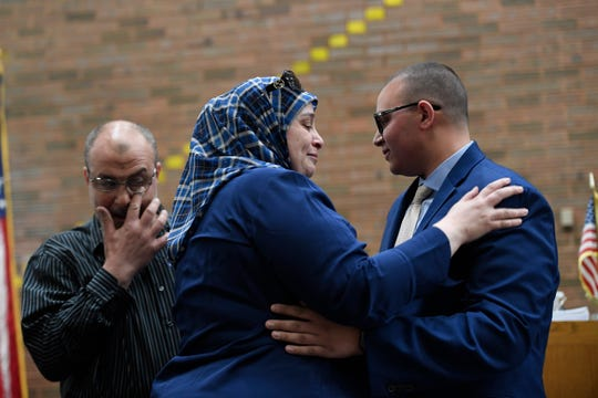 Ahmad Awawdeh's parents become emotional after their son is sworn in as a Clifton police officer on Tuesday, April 16, 2019.