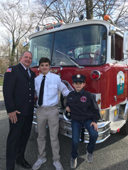 """the Murphy's in front of the 1972 pumper, with nickname """"Pop Pop"""" above the windshield."""